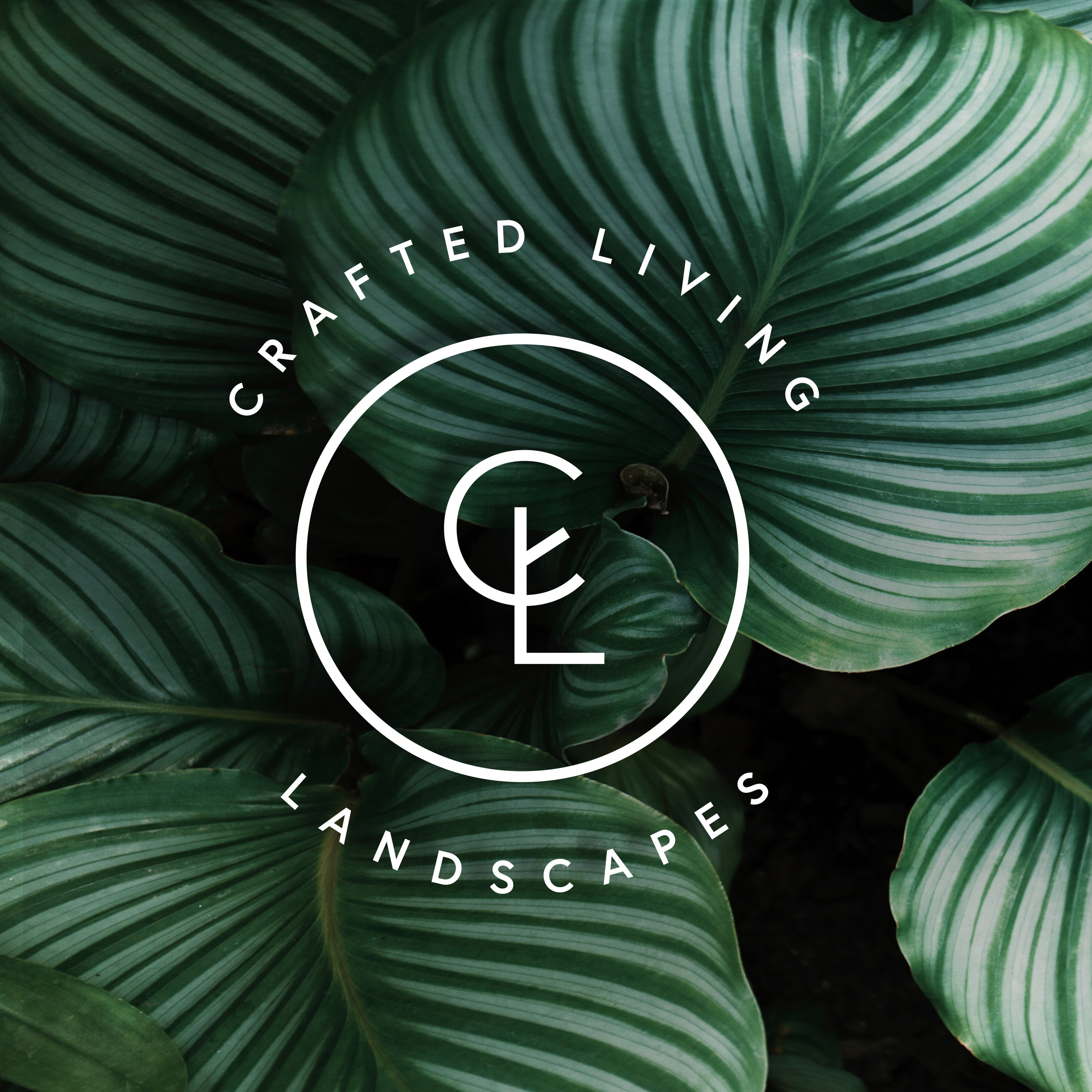 Crafted living landscapes logo with foliage background and white lettering