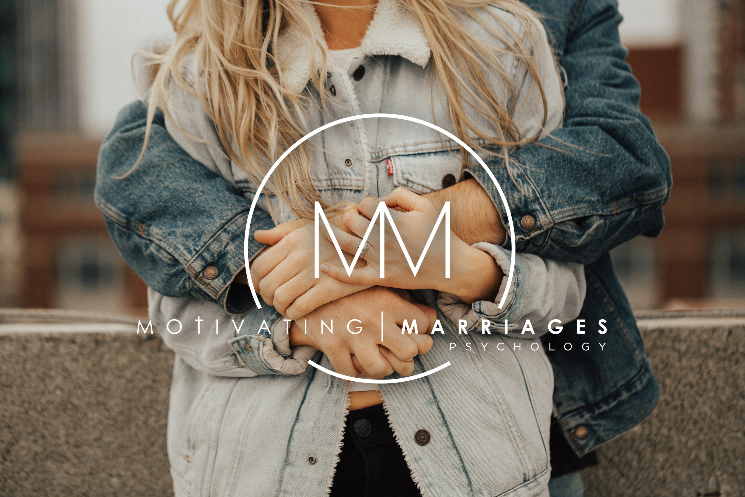 Motivating marriages psychology logo couple in denim hugging with white logo and lettering