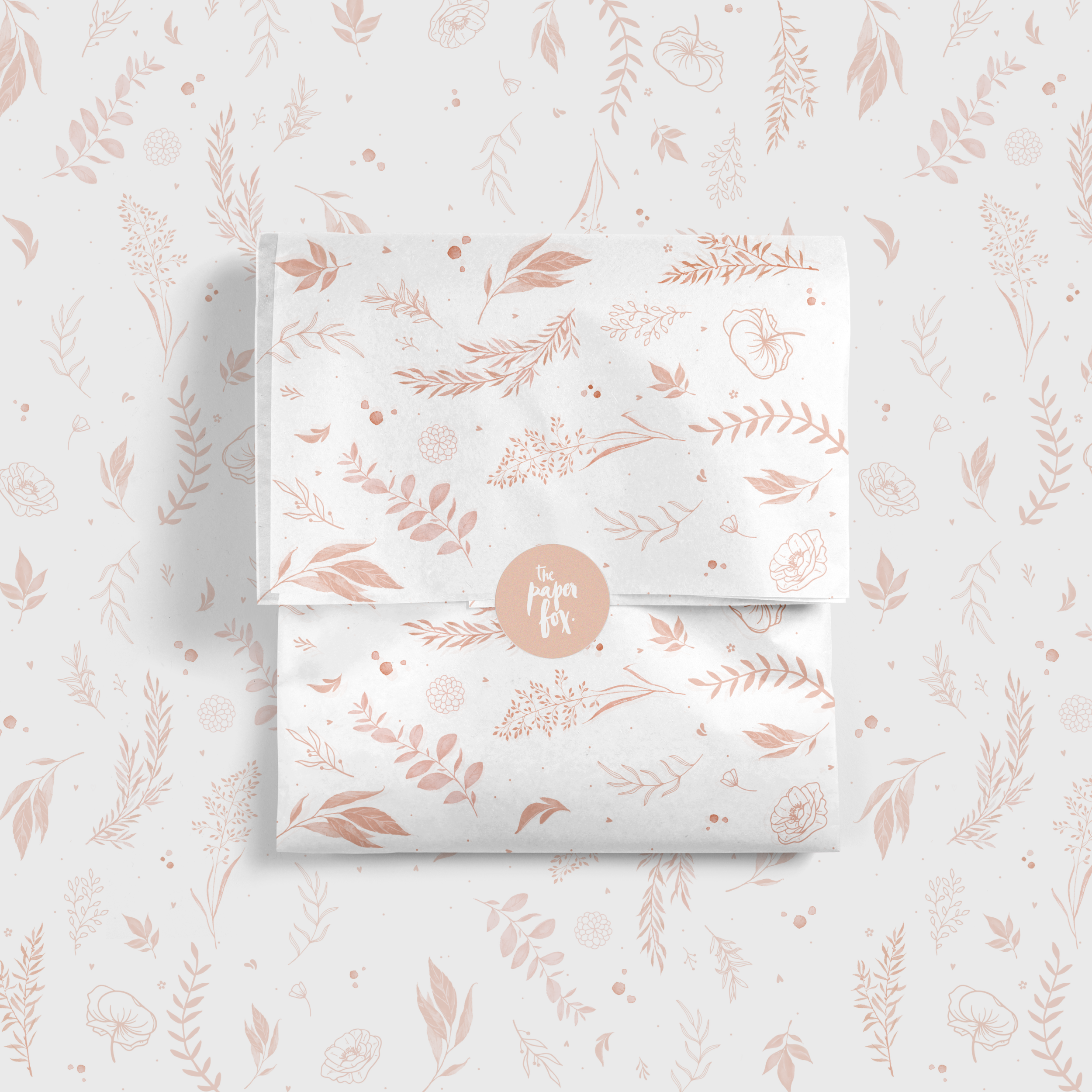 GIft wrapped in white tissue paper with peach coloured floral design print