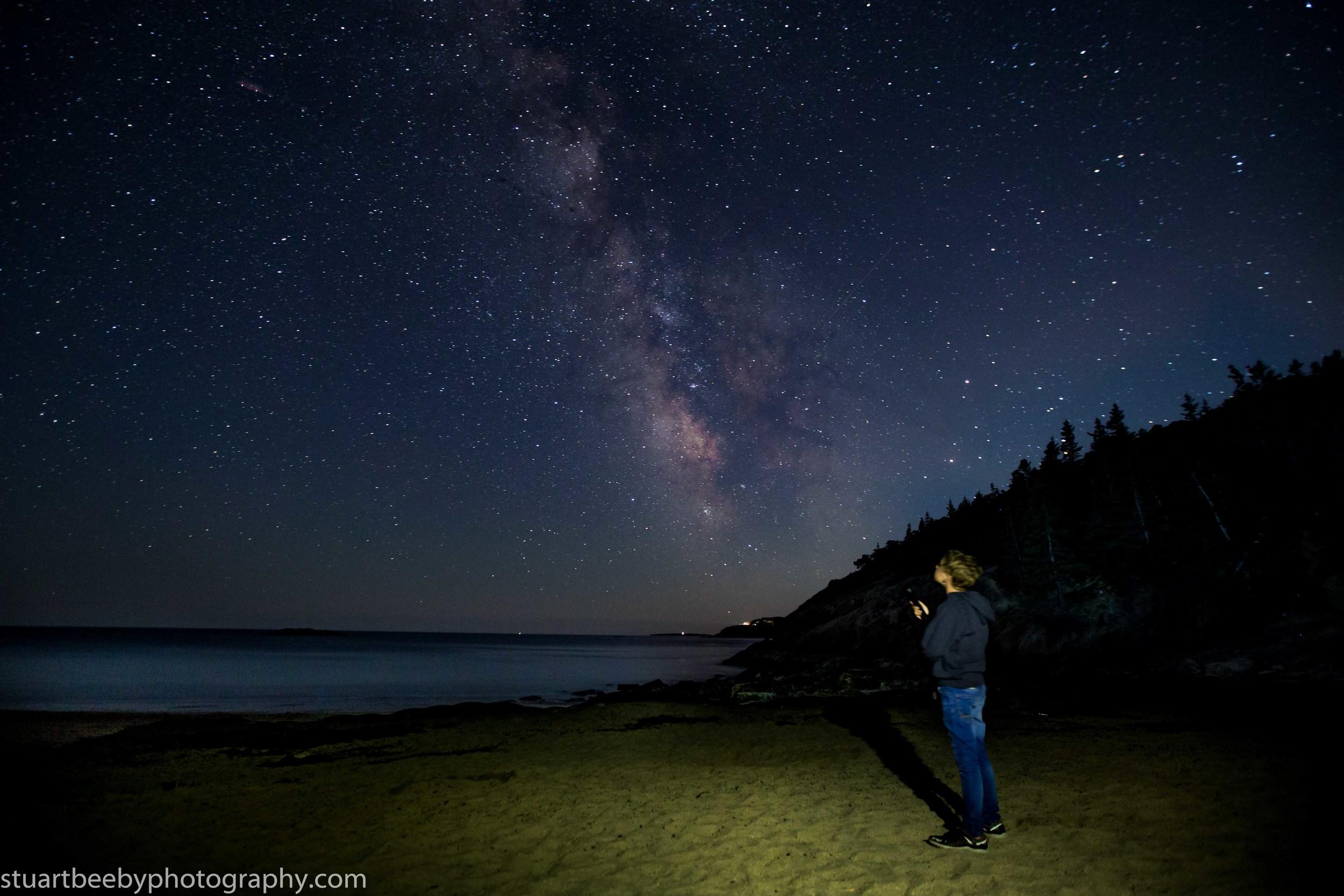 Oliver star gazing on Sand Beach, Acadia National Park