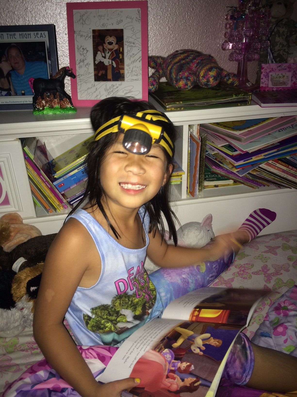 Busted!  I walked in on Ladybug reading books after lights-out with her minor's headlight.  How does one reprimand such cuteness??