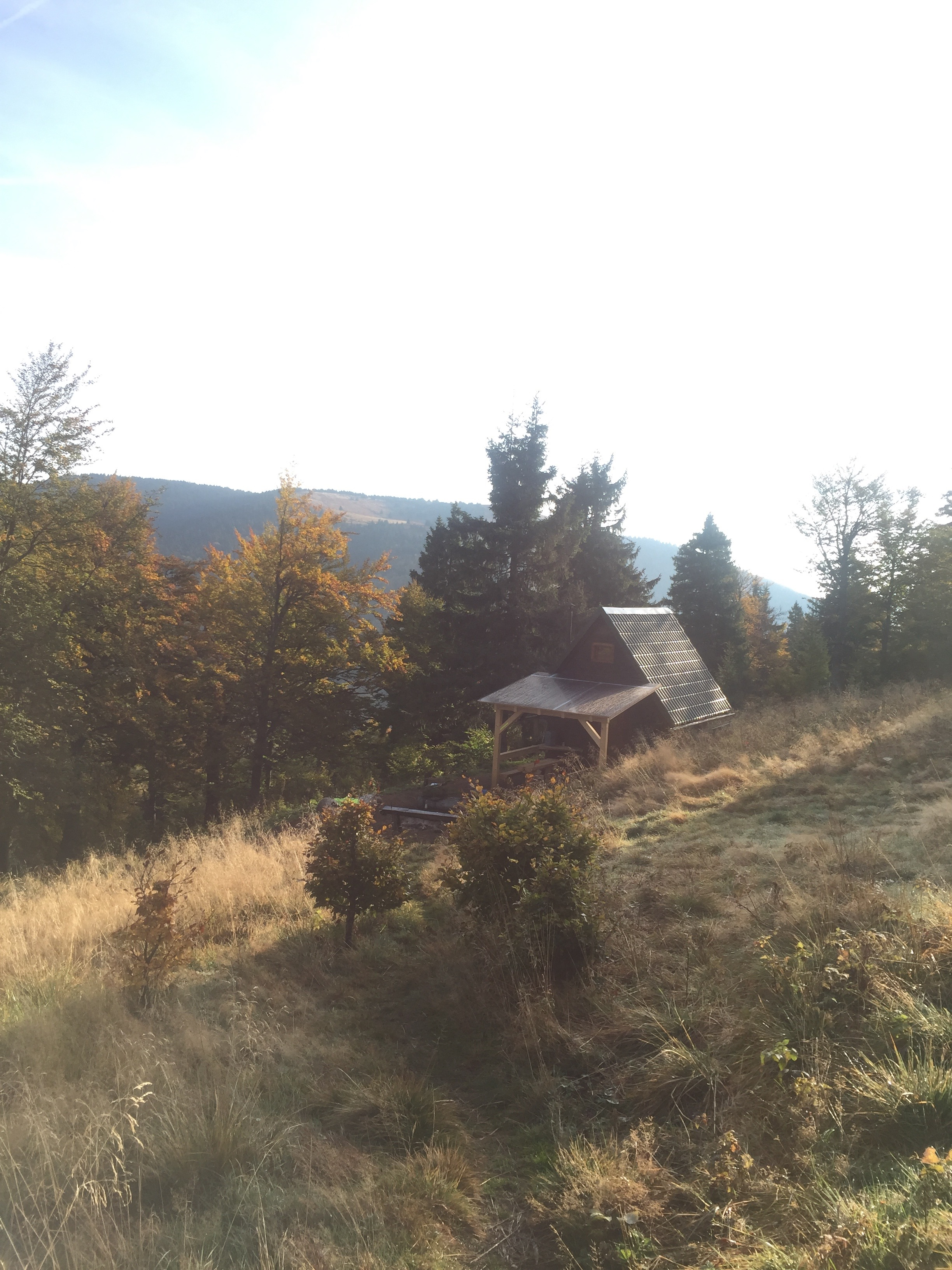 Mountain hut in the mountains in the morning.