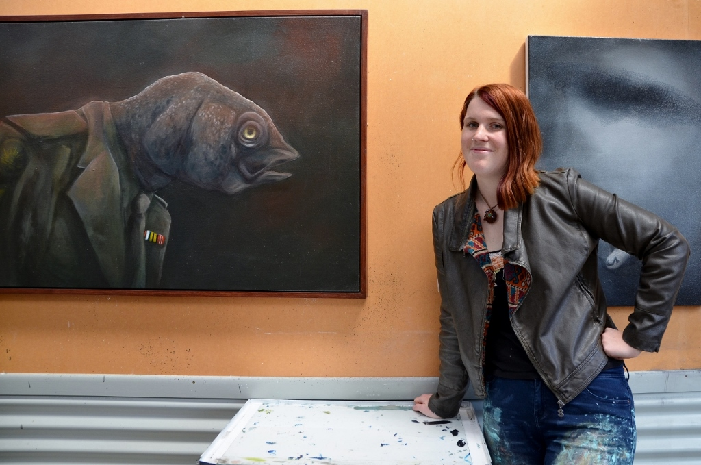 Kate with the one painting she will never part with, the  Stunned Mullet  as part of her PTSD body of work from 2013.