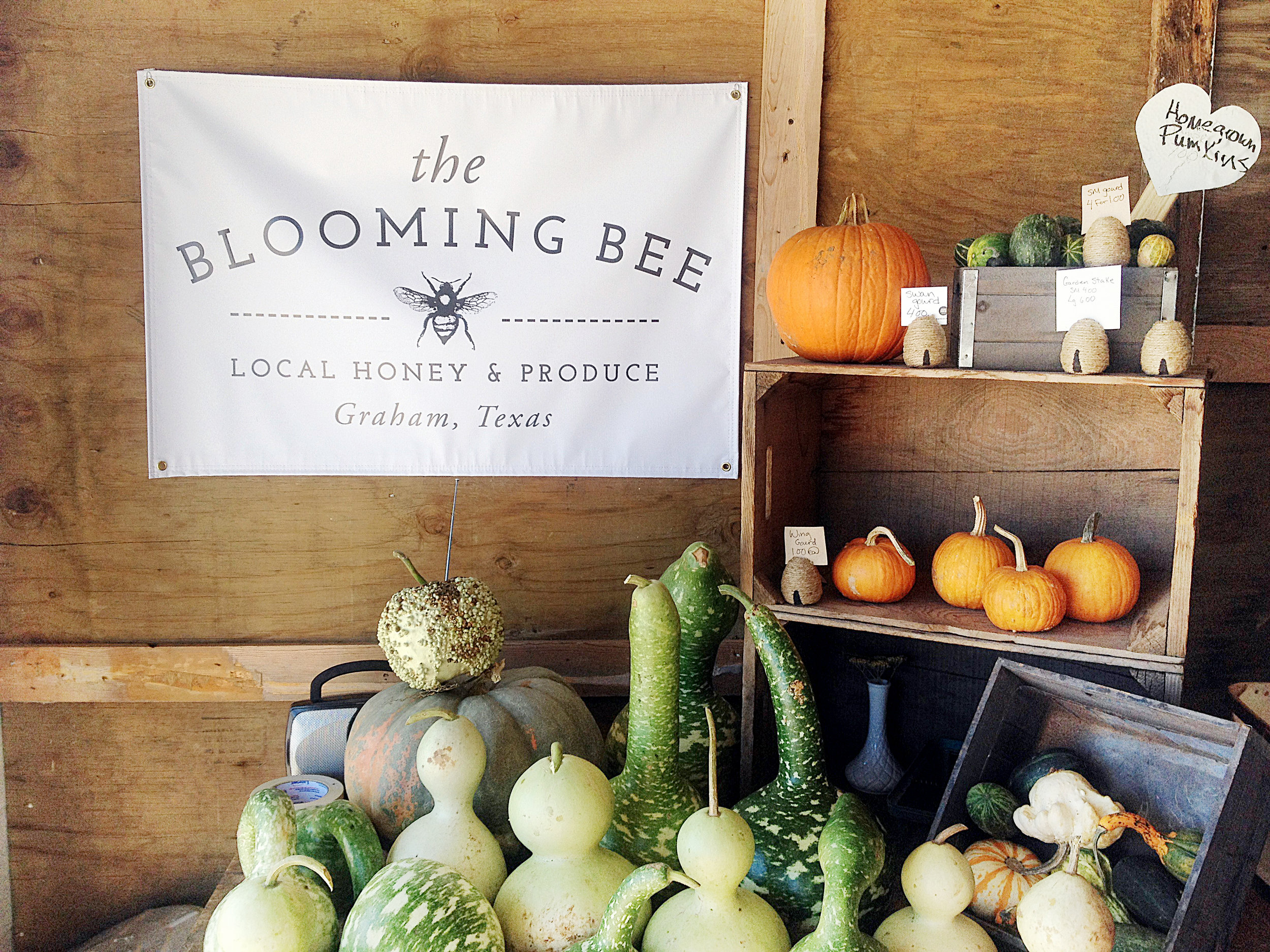 blooming bee farmers market sign