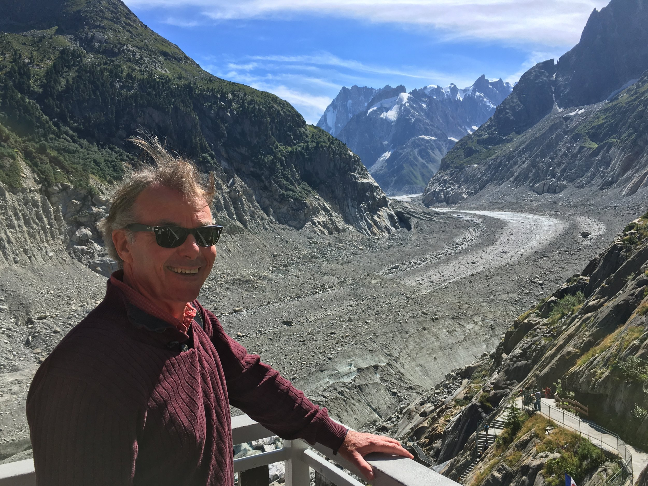 The glacier can not even be  seen  from Montanvert. It is around the corner having retreated 10  miles  thanks to climate change- why am I smiling!? Copyright Henderson, 2016.