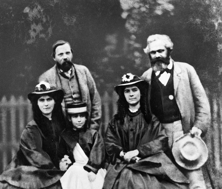 Eleanor Marx (front centre) in 1864 with her sisters Laura and Jenny. Behind are Frederick Engels and their father Karl Marx
