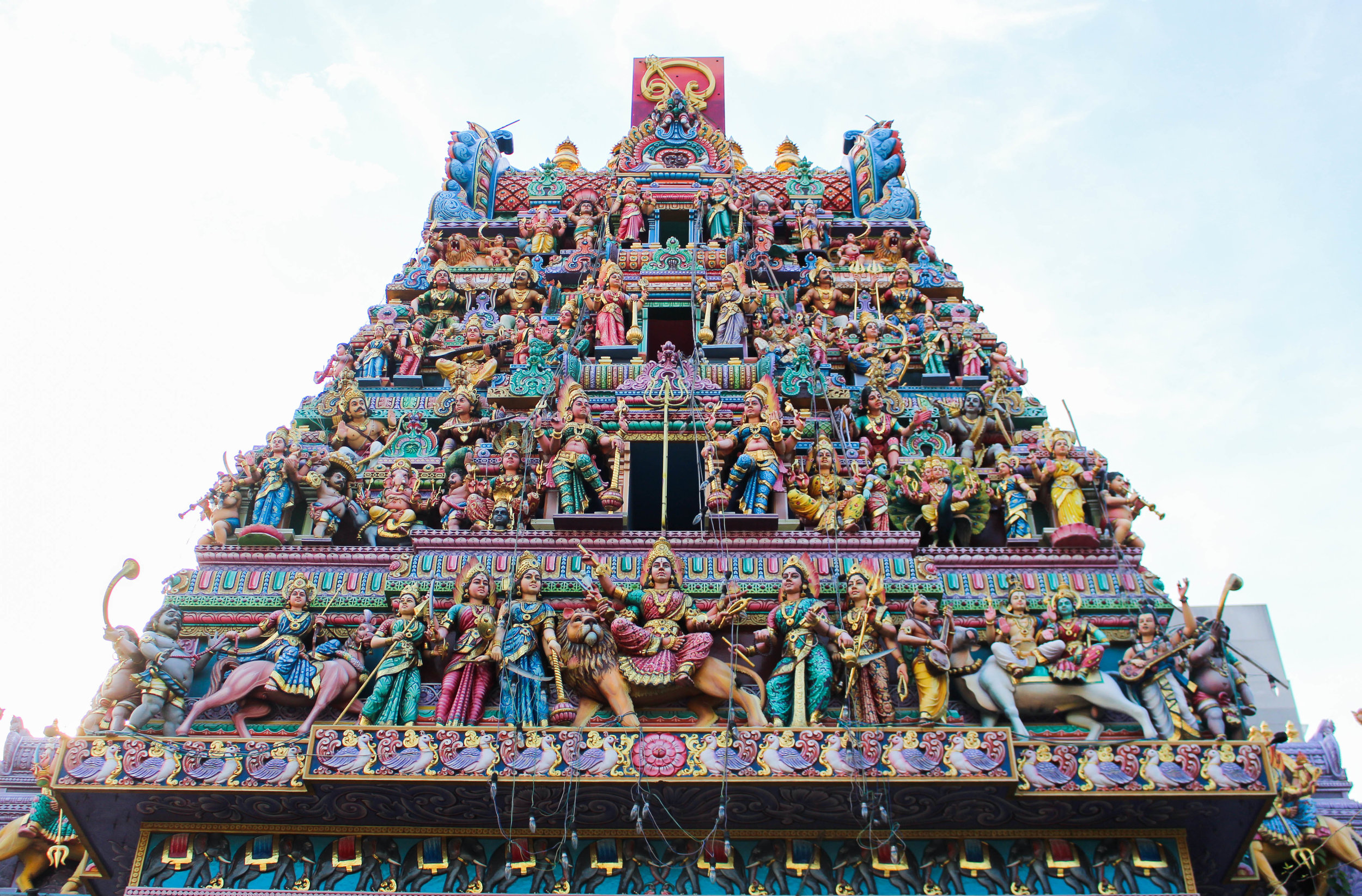 THE   GOPURAM  (MONUMENTAL TOWER) LOCATED AT THE ENTRANCE OF SRI MARIAMMAN TEMPLE