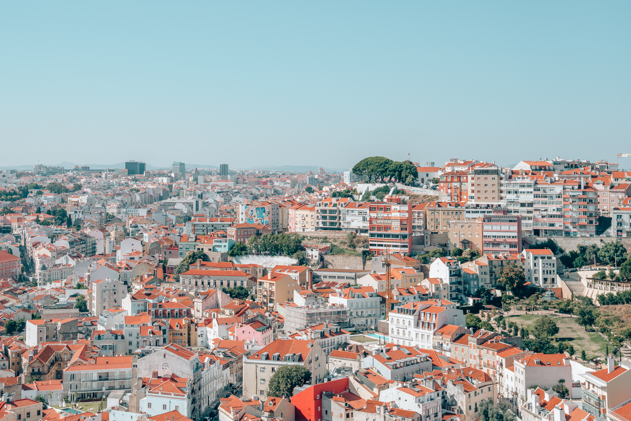 Overlooking the city of Lisbon and its famous orange rooftops from Miradouros