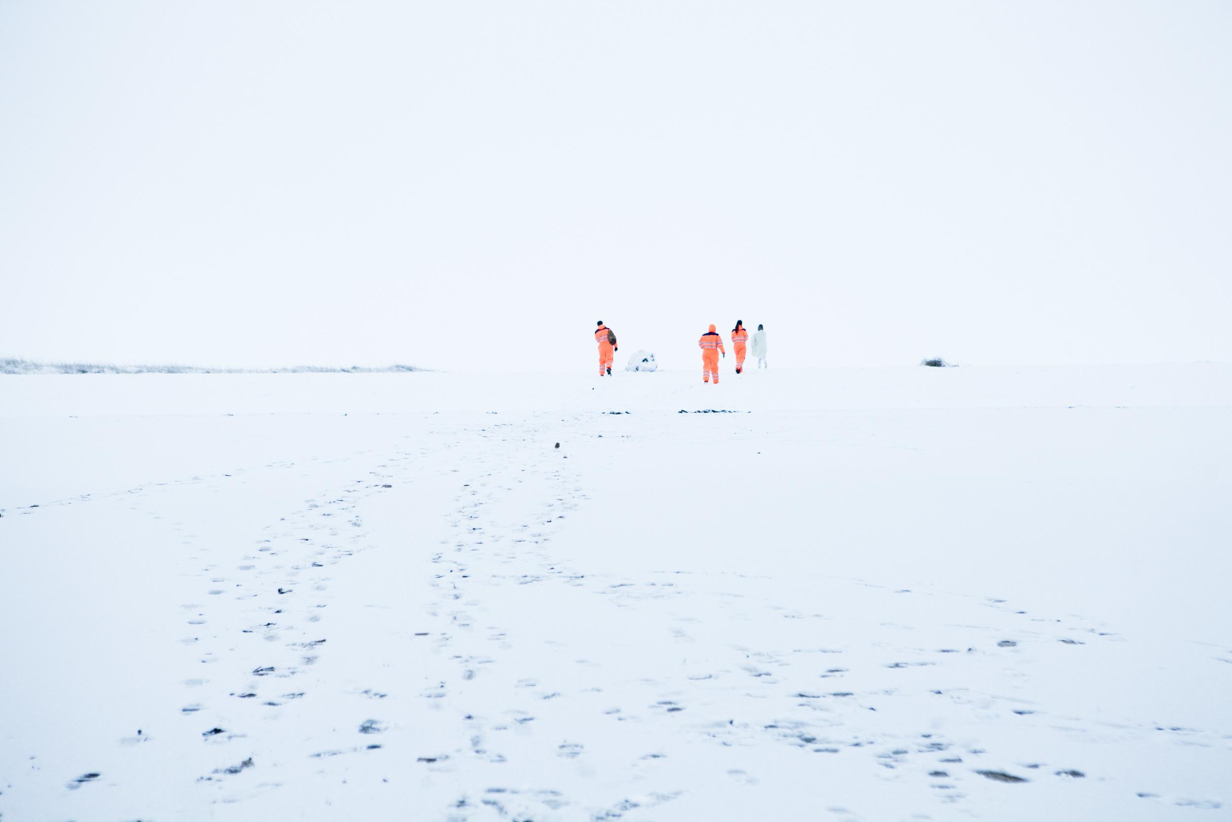 The orange suits kept following me