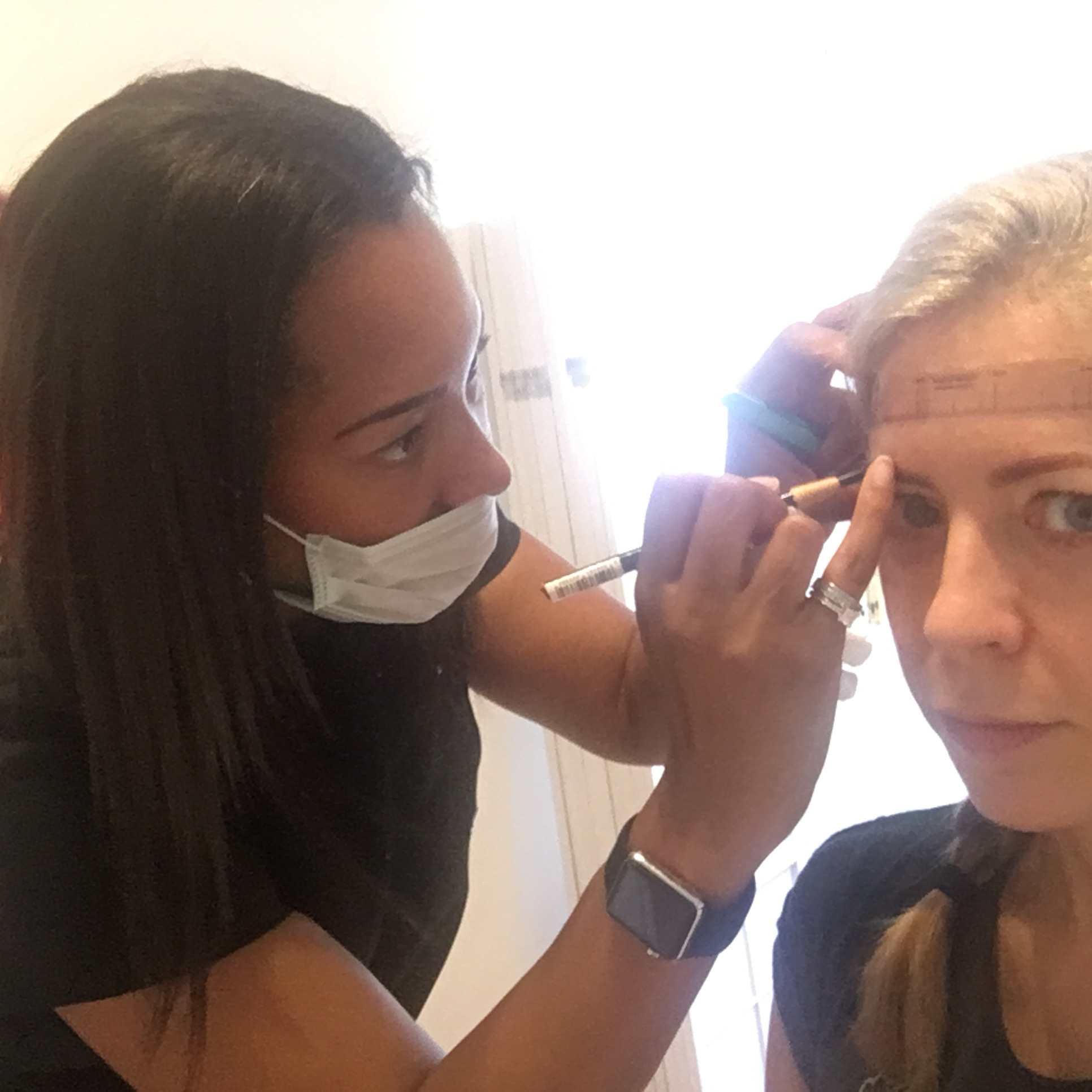 Sian Dellar, eyebrow microblading expert, first measures up my brows