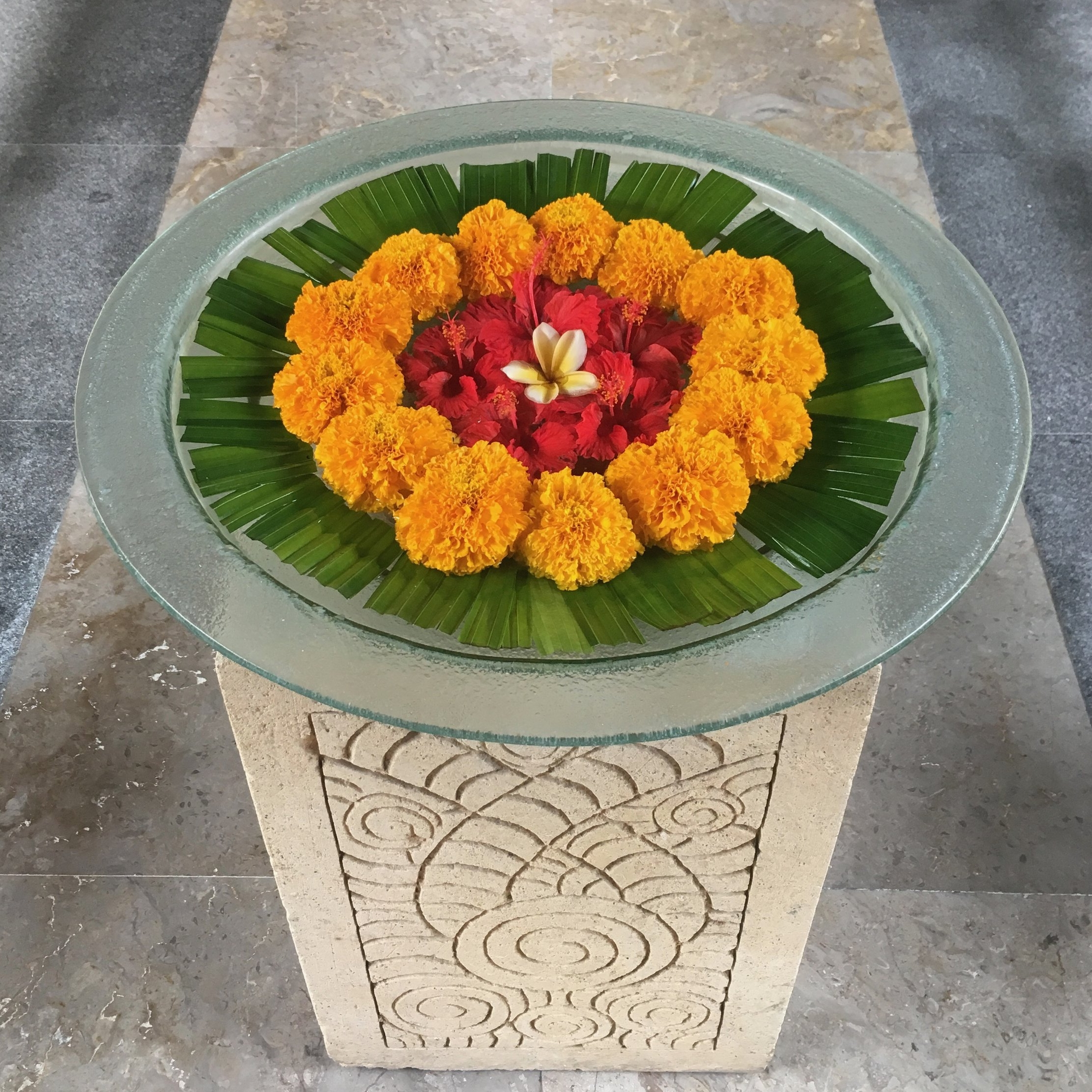 Marigolds and frangipani decorate the entrance to the spa at the Oberoi