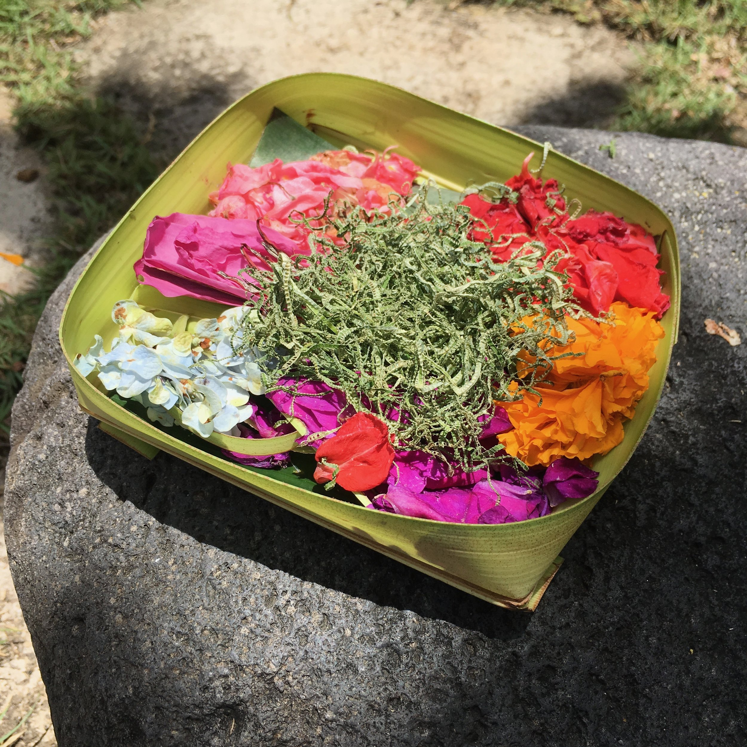 Floral offerings - often including food and a small coin - are put out every morning