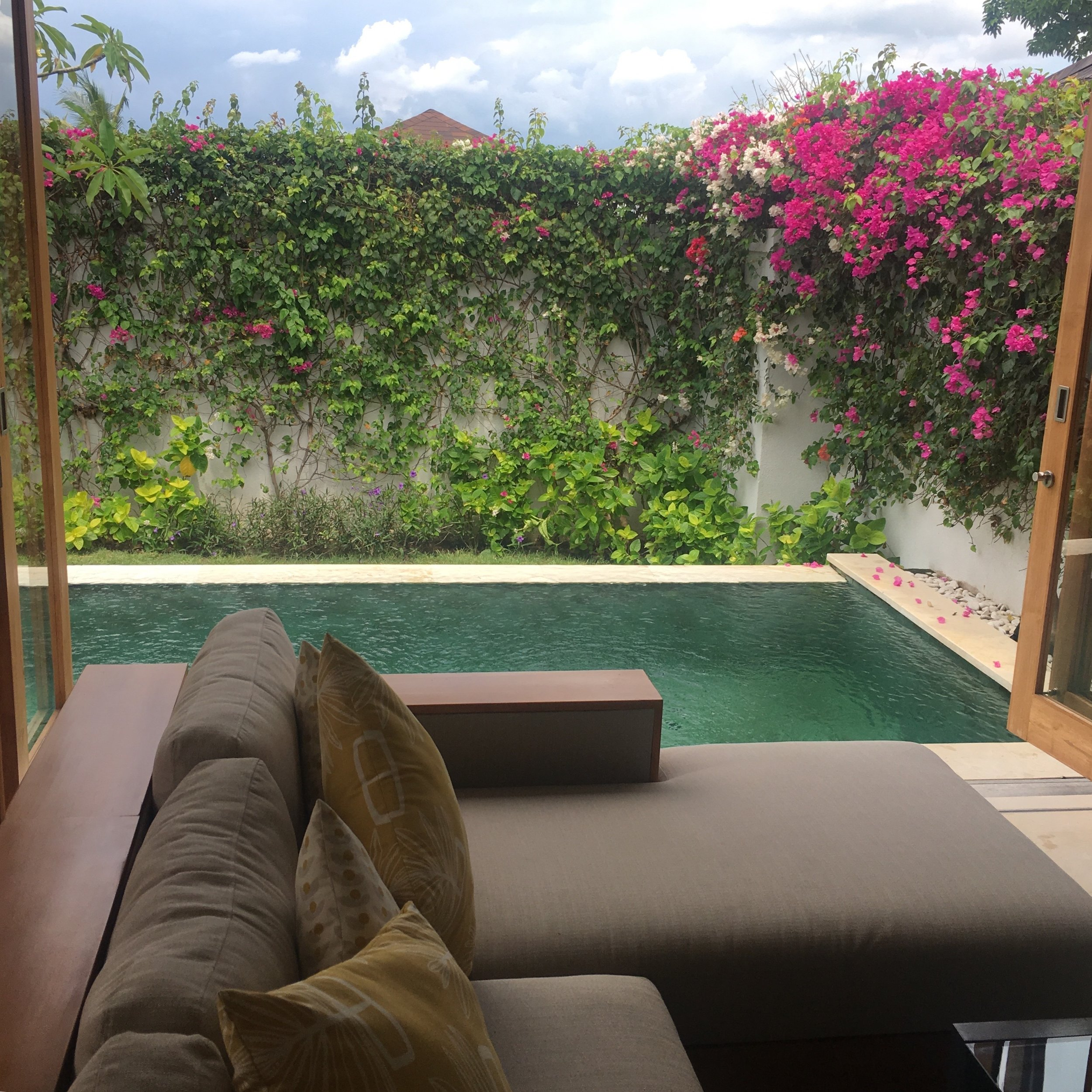 The villa's spacious sitting room opens out onto a private pool