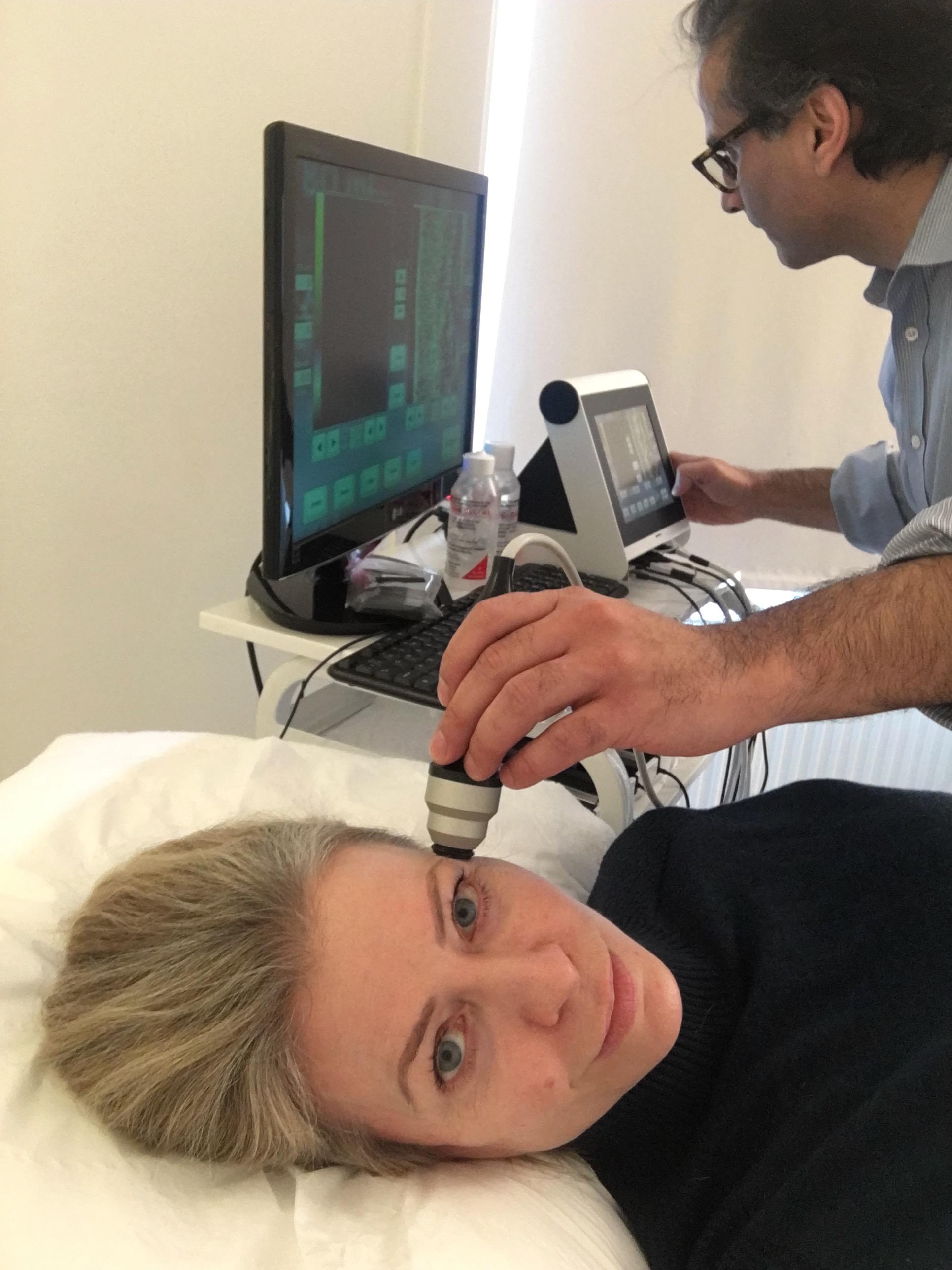 Tariq Karim measures the state of my skin at Santi Labs