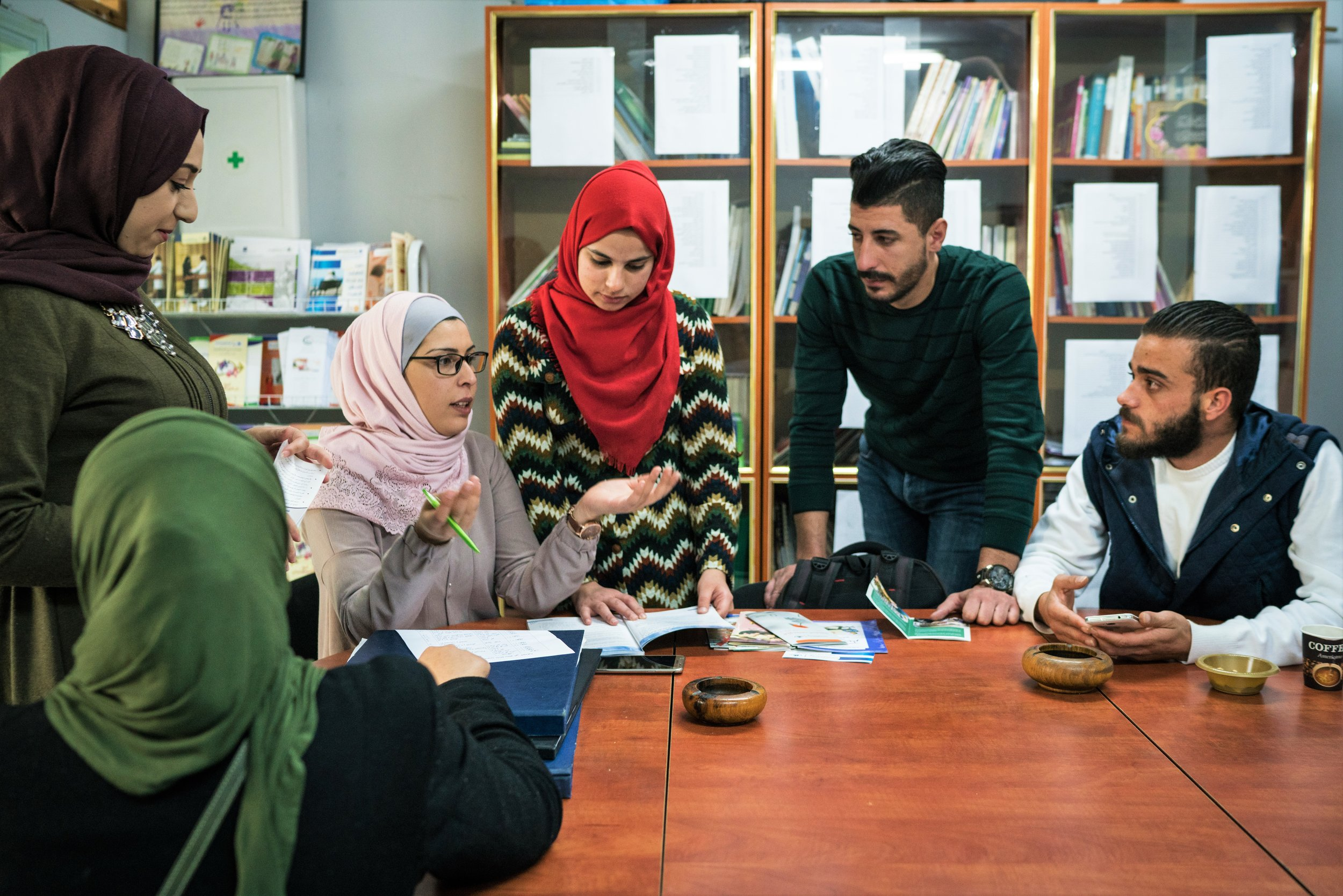 Mahmoud (furthest right) working with other volunteers to plan activity