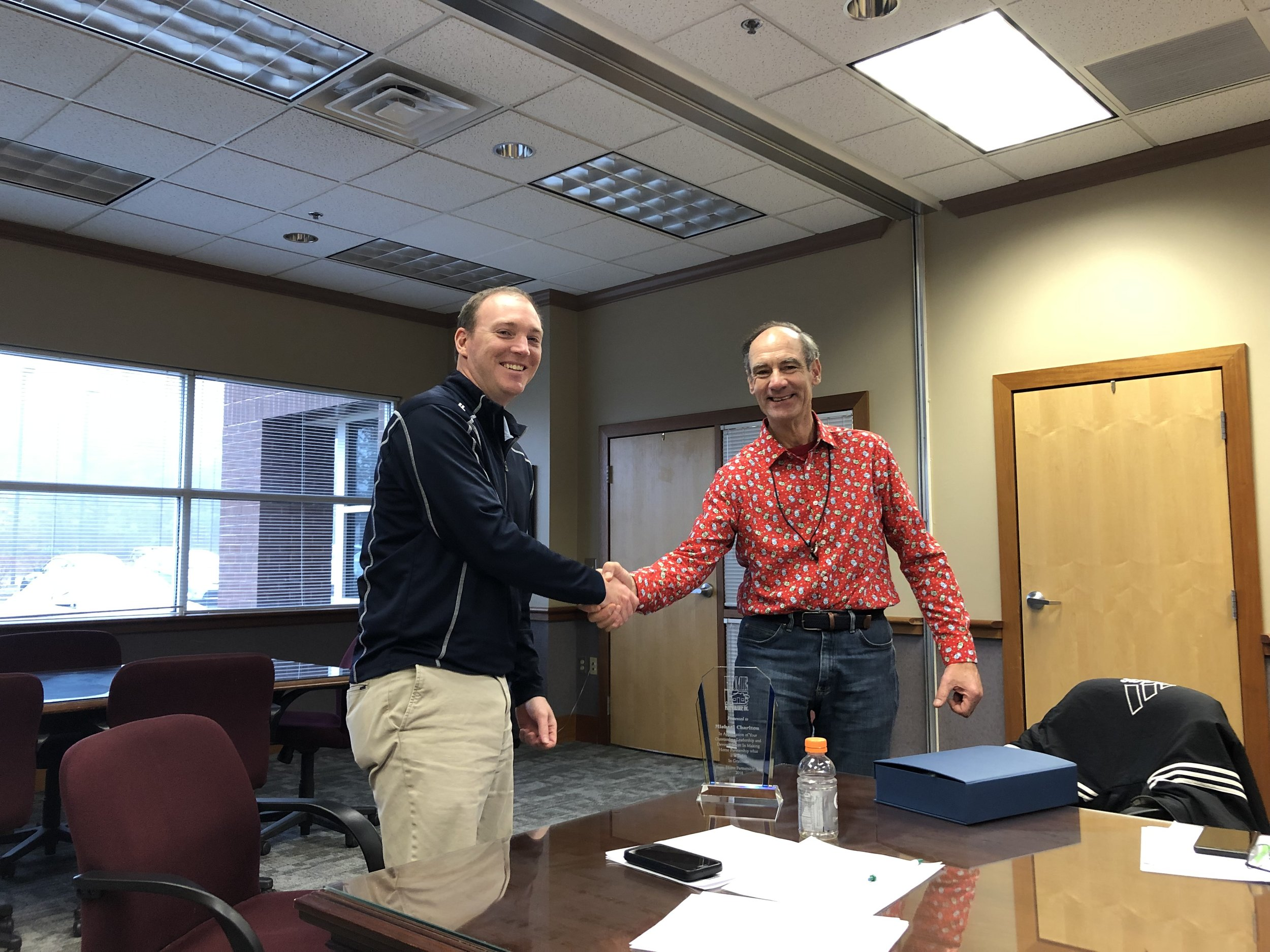 With Much Appreciation - Chair Dave Stromberg (right) presents Michael Charlton (left) with the Distinguished Board Member Award for his outstanding service to Home Partnership as a board member and officer of the organization.Dec 2018