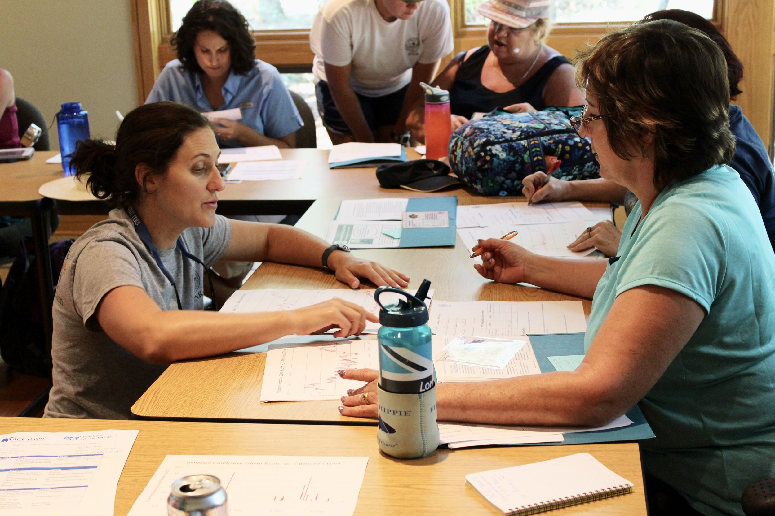 ACE Basin NERR education coordinator Julie Binz discusses a workshop activity with participating teachers. (Photo: E. Weeks/SCDNR)