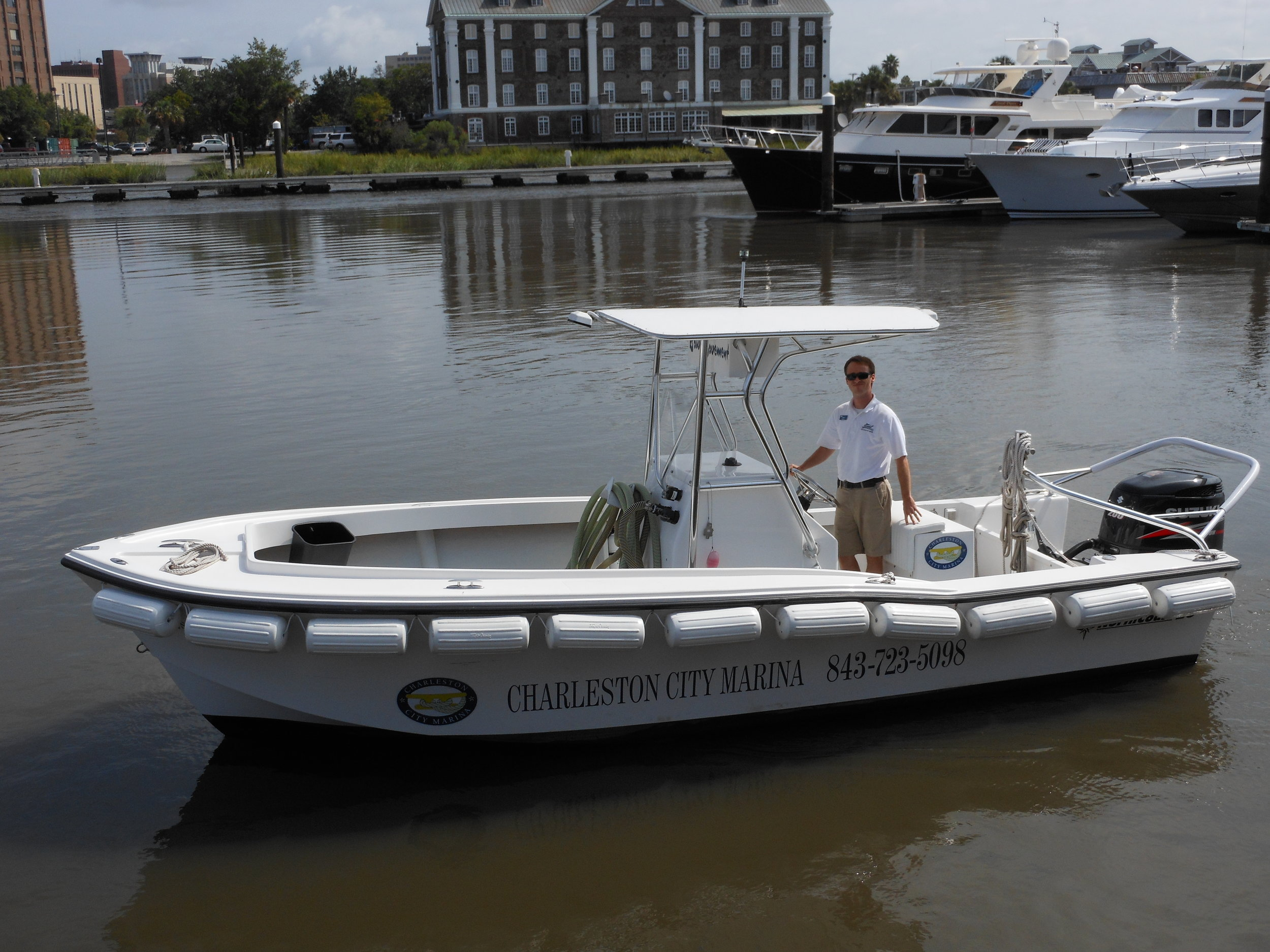 A Charleston City Marina staffer mans the  Bow Movement , one of three pumpout boats at the marina where other vessels can discharge their sewage. (Photo: Scott Meister/SCDNR)
