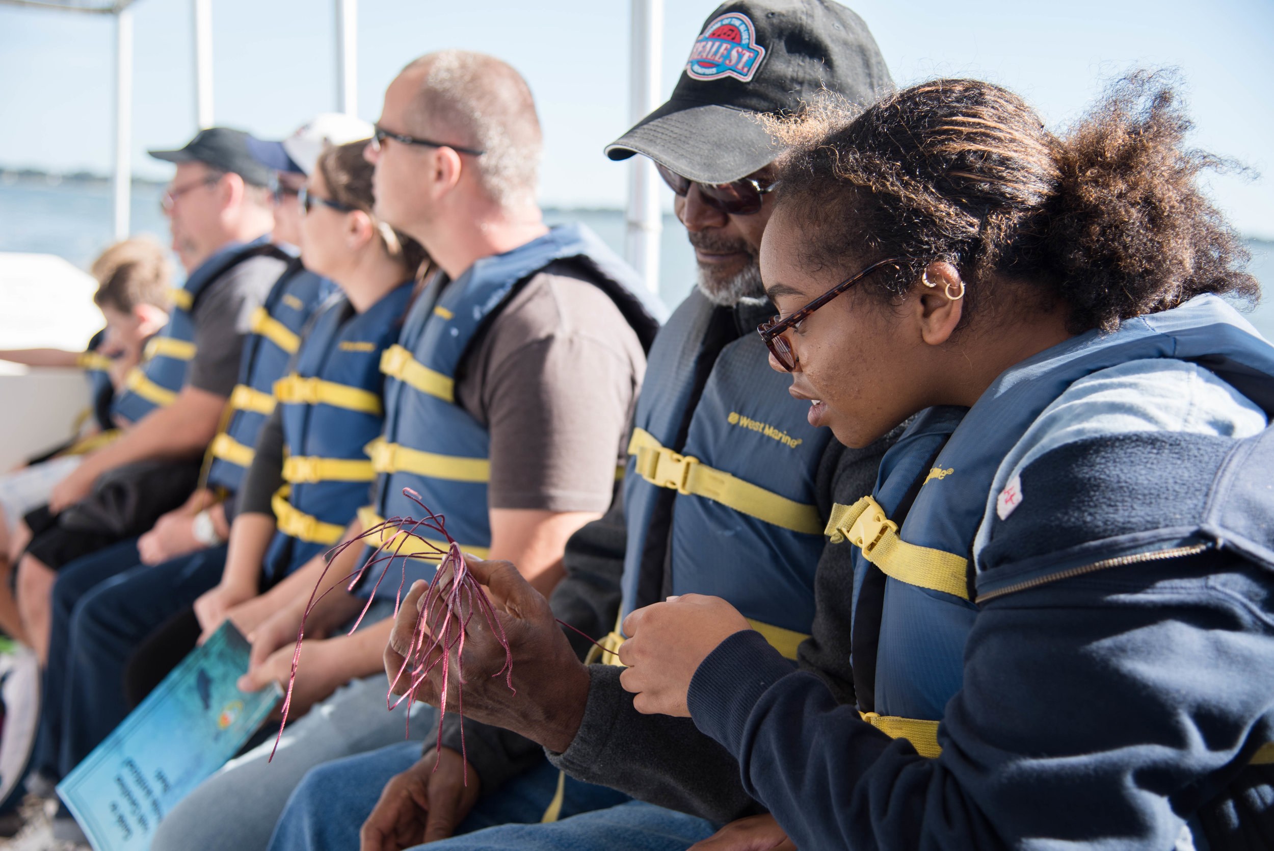 Passengers on each of our three educational cruises got to pull a trawl net and see some of the plants and animals (like this sea whip, a type of coral) that live in our estuaries. (Photo: Taylor Main)