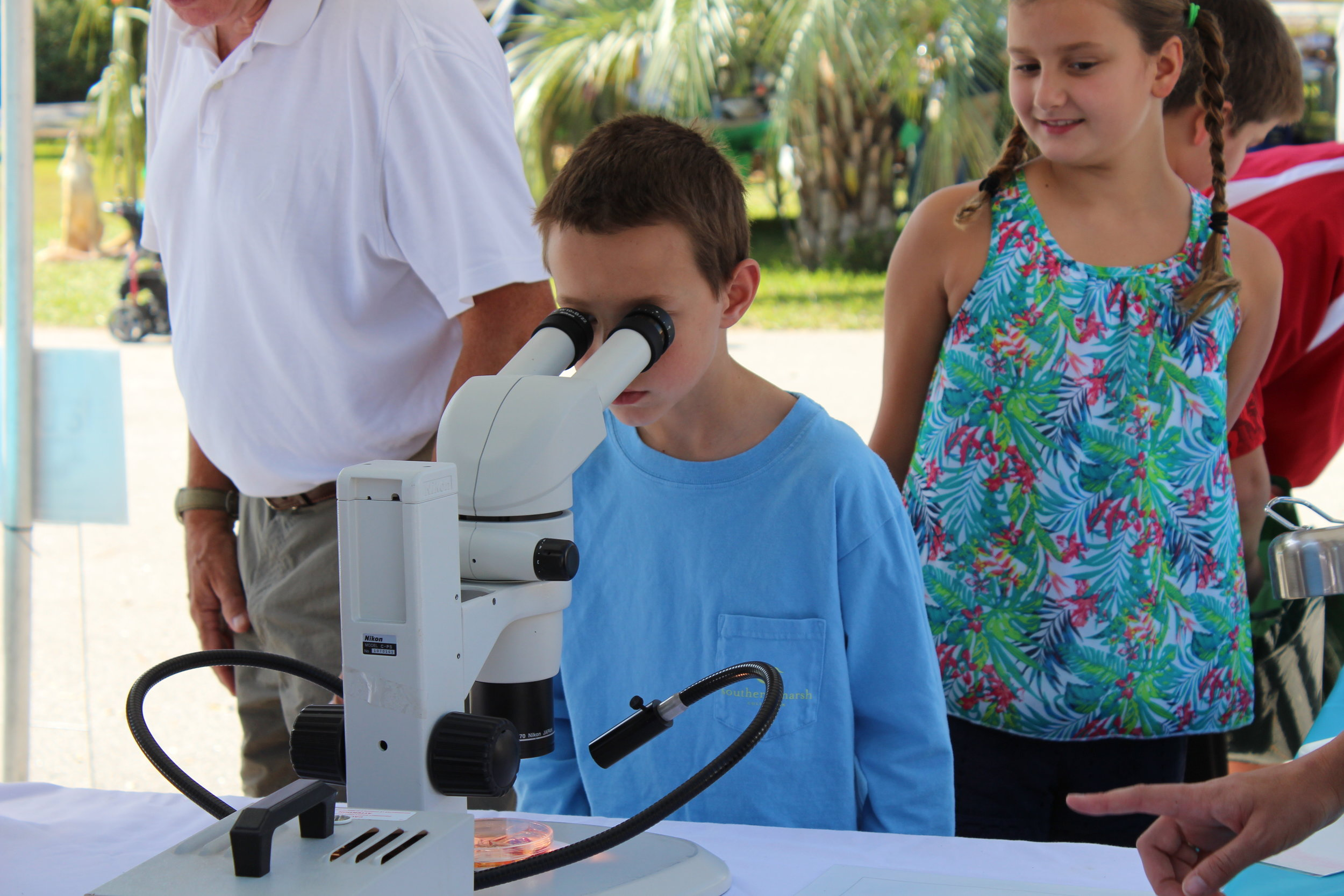 Just like SCDNR biologists, kids got to peer through microscopes at the tiny worms and other invertebrates that live on the seafloor and provide food for our favorite fish, crabs, and shrimp. (Photo: E. Weeks)
