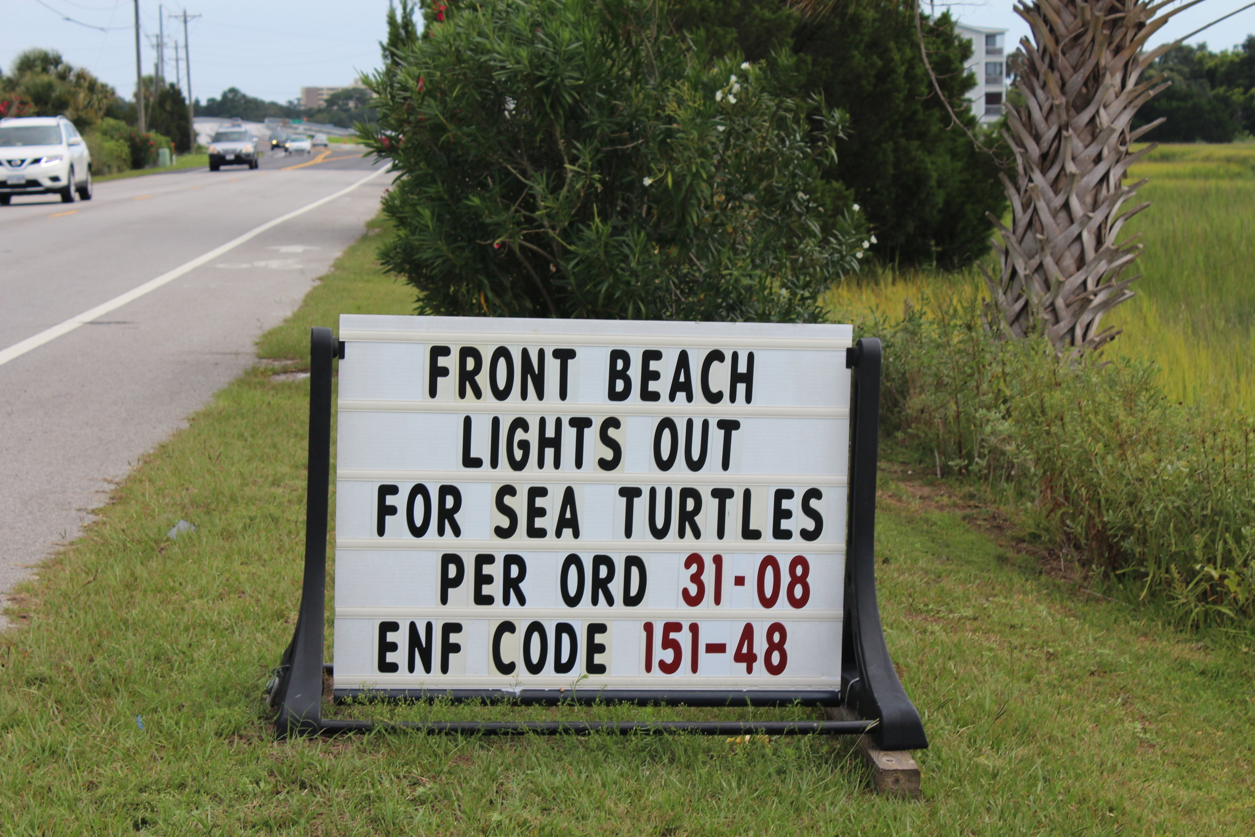 A reminder to keep lights out at night for sea turtles at the entrance to Folly Beach in 2015 (Photo: E. Weeks/SCDNR)