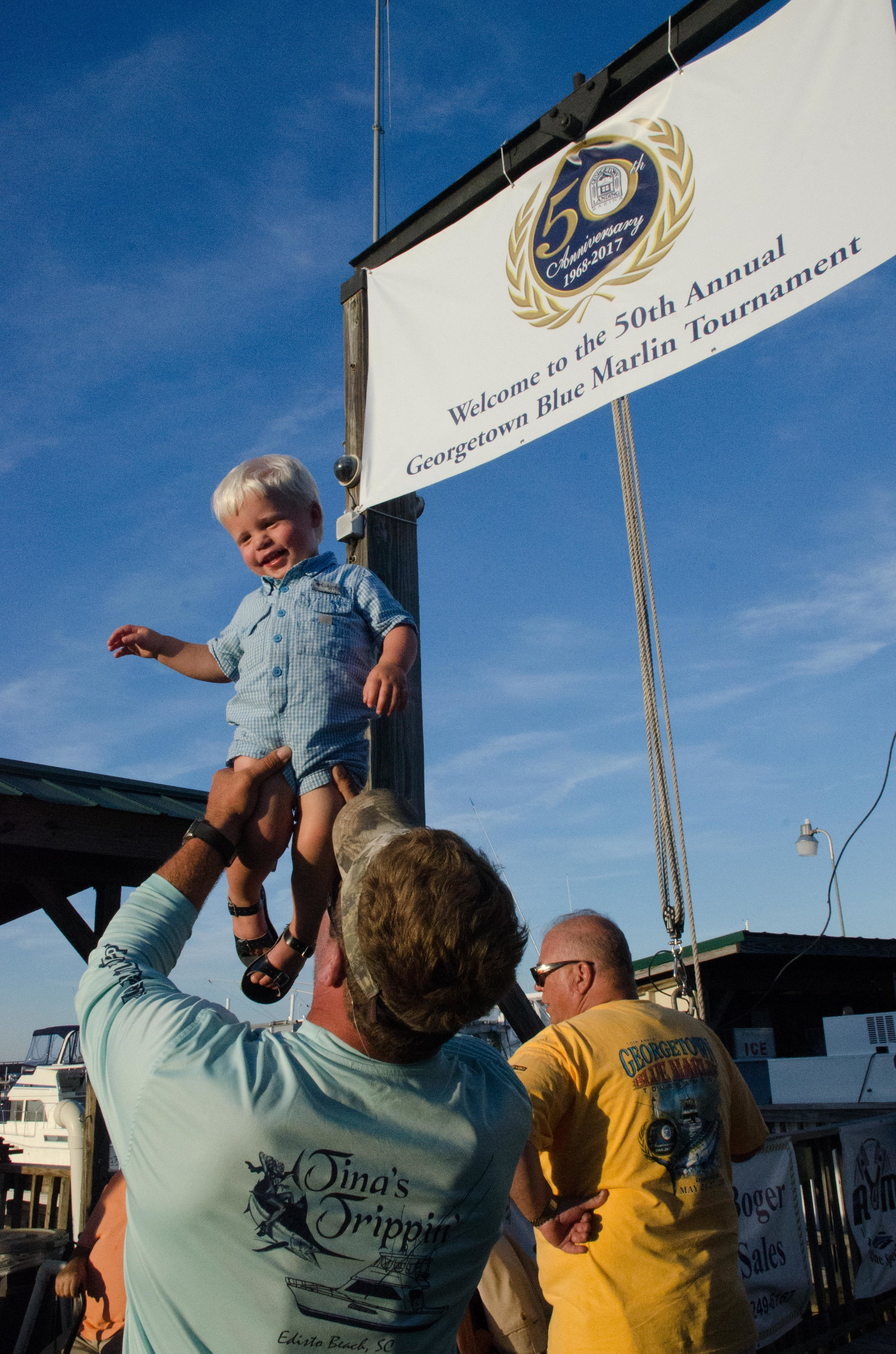 The youngest member of the Tina's Trippin' team celebrates the boat's prize winning dolphin_credit Cameron J. Rhodes.jpg