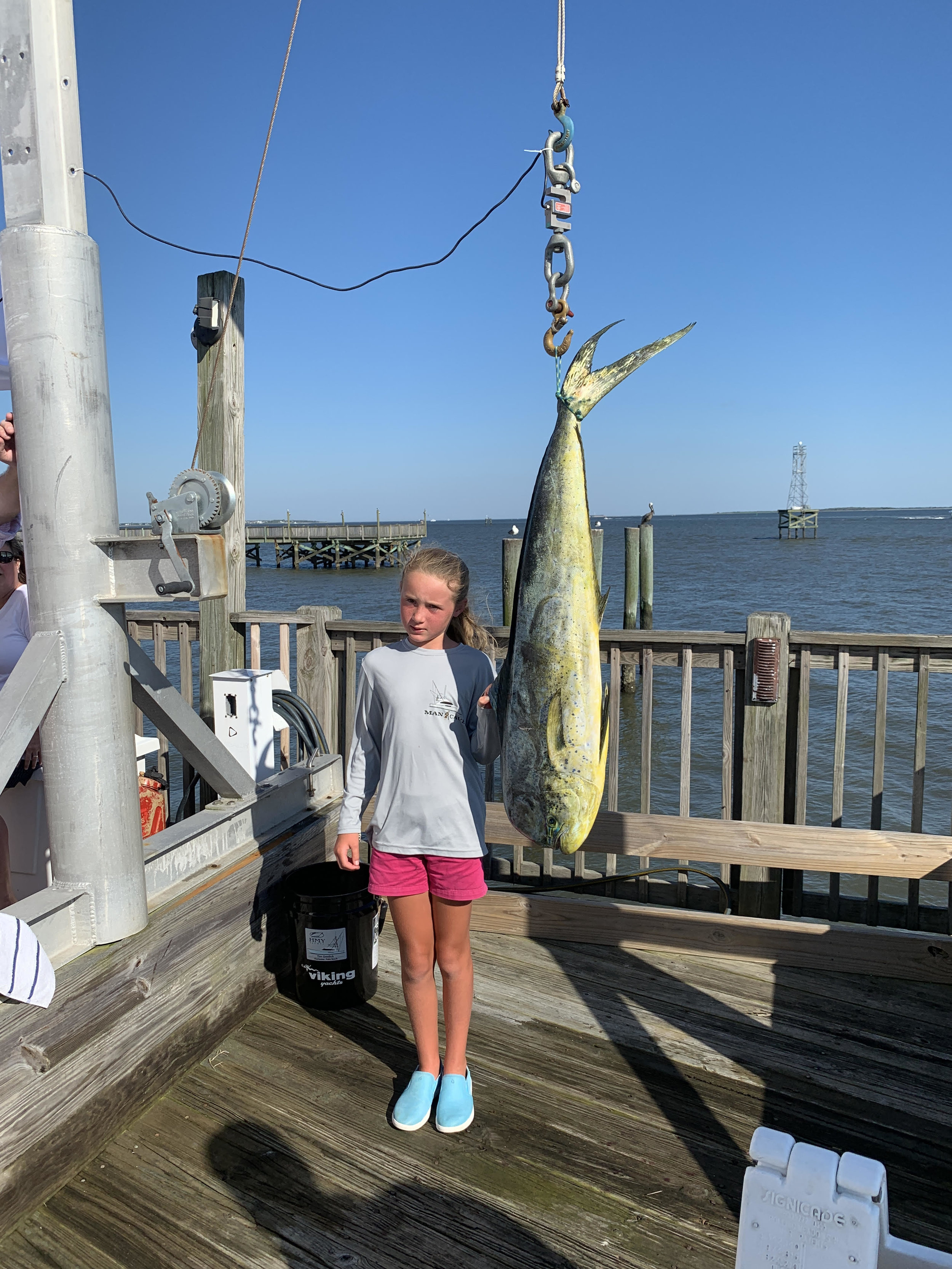 Julia with a nice dolphin she caught on the first day of fishing. Photo courtesy of Tim Gredick