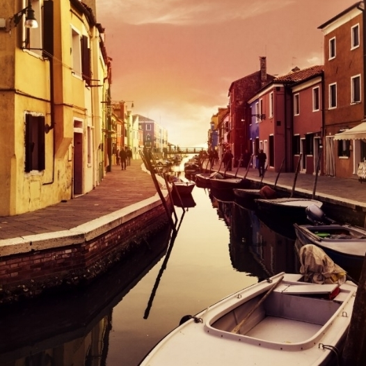 beautiful-sunset-with-boats-buildings-and-water-sun-light-toning-burano-italy_1220-1325.jpg