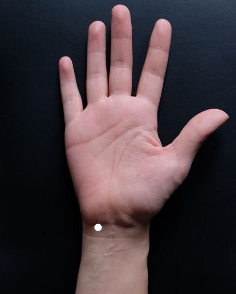 Where:  You can find this acupuncture point in a depression just below your wrist bone, on the inside of the tendon (flexor carpi ulnaris).  How to:  Massage this area for a minute while breathing deep and slow, and in a relaxed environment.