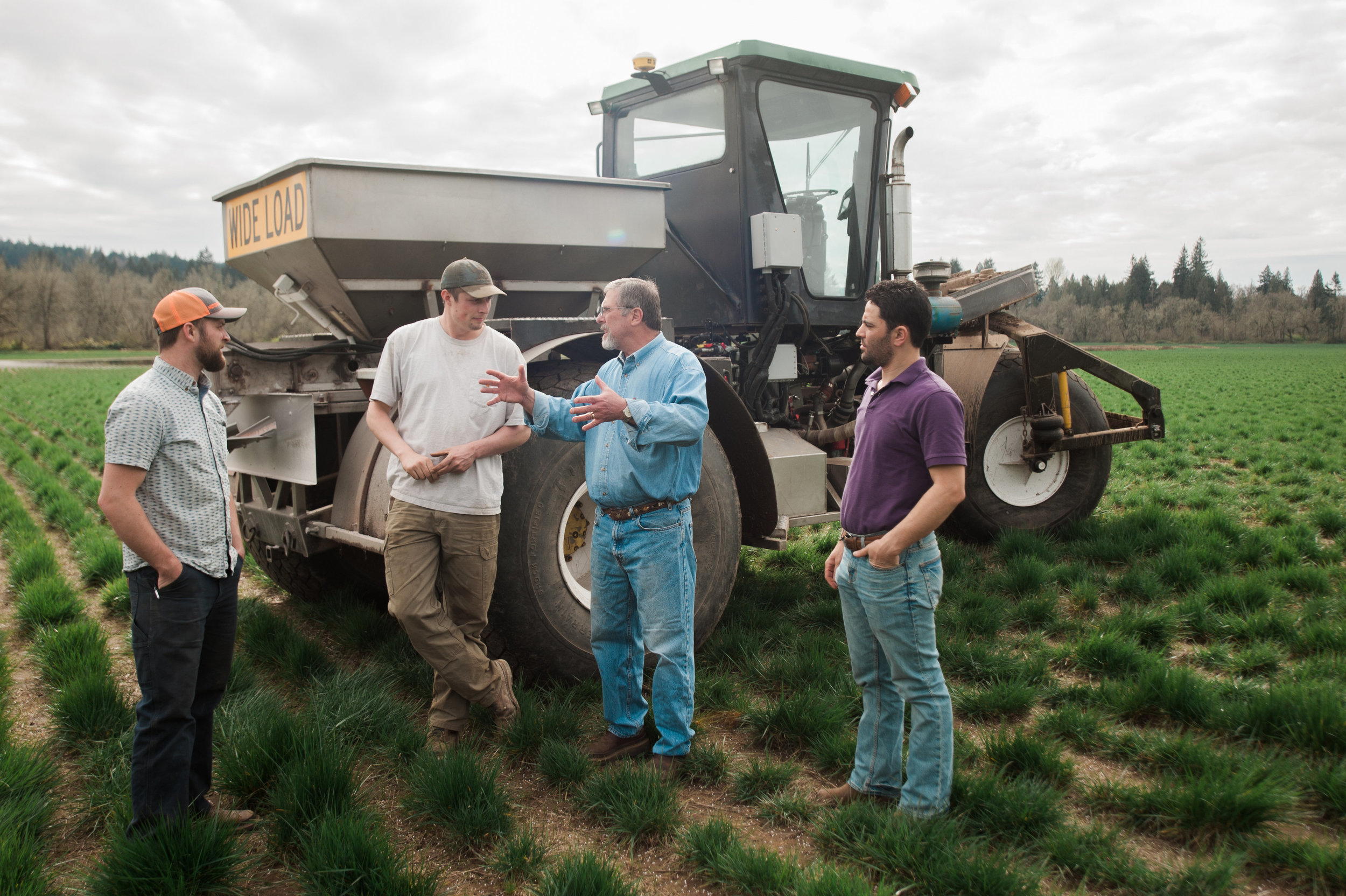 Rich talking to guys around farm equipment.jpg