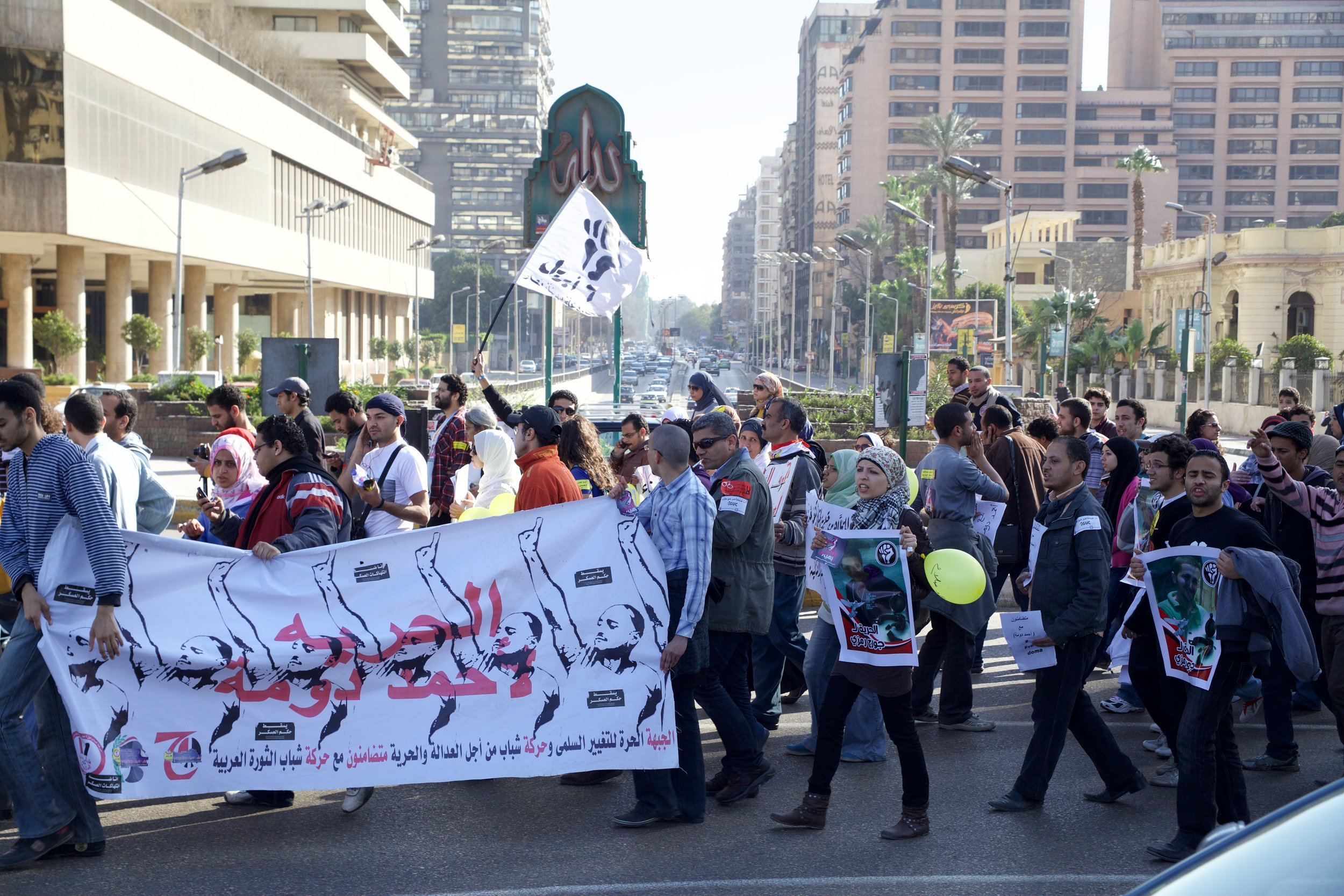 Protesters march through the Dokki neighborhood of Cairo.
