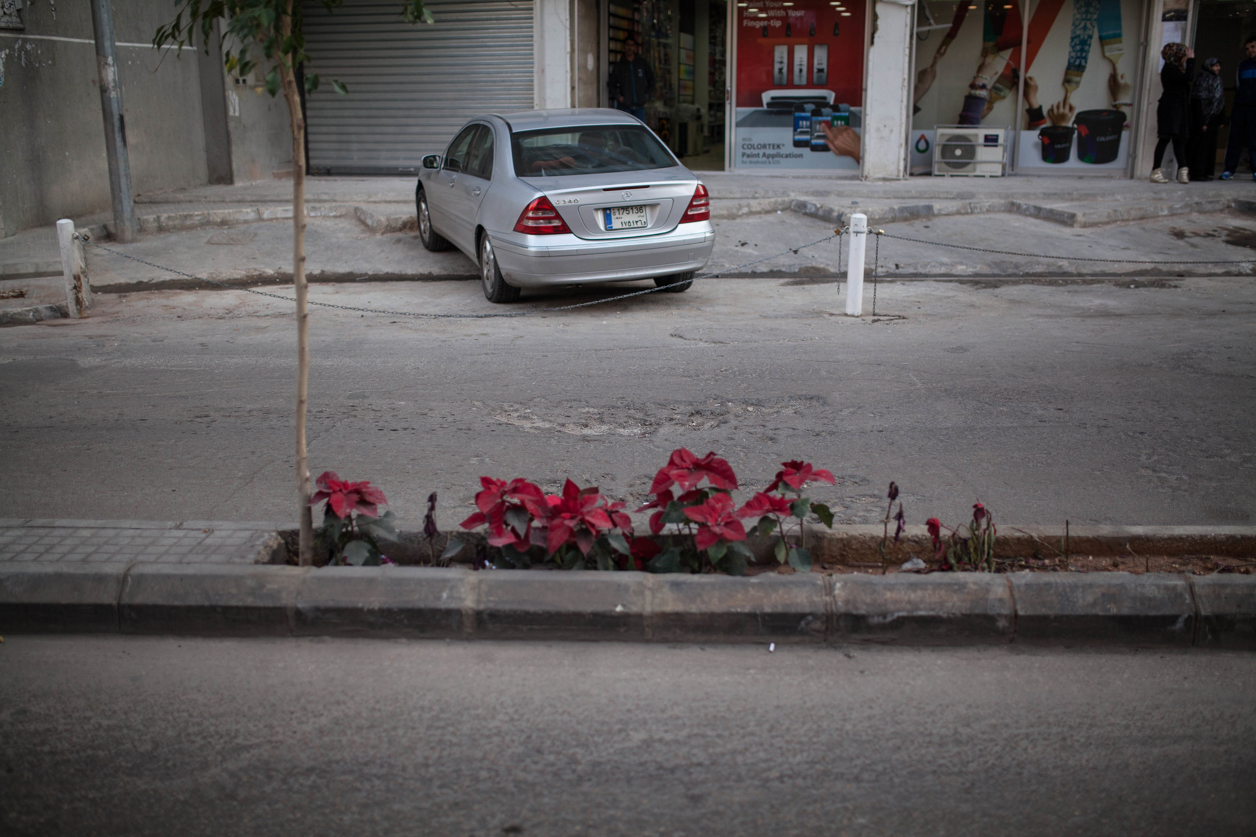 Scarred pavement just days after a car bomb detonation in the southern suburbs of Beirut.