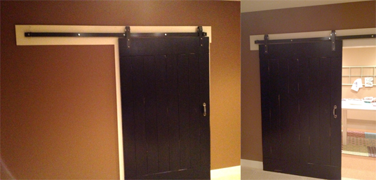 Barn door by  Johnson Builders  opens to reveal the homeowner's crafting room.