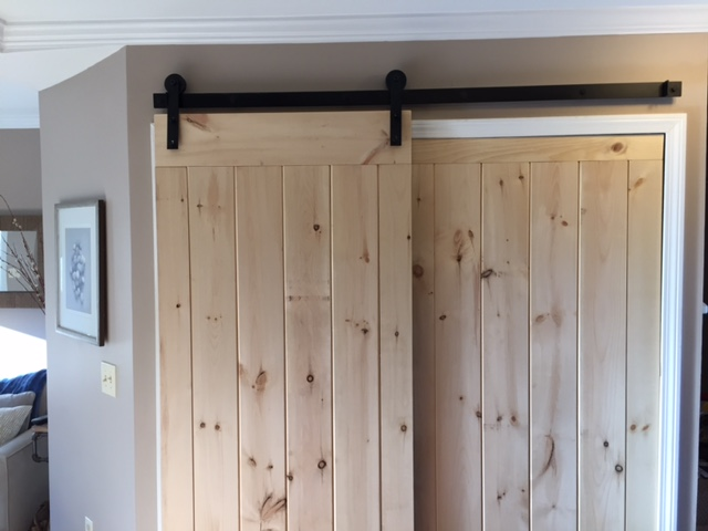 Newly finished barn doors temporarily in place before being finished with stain or coat of paint.