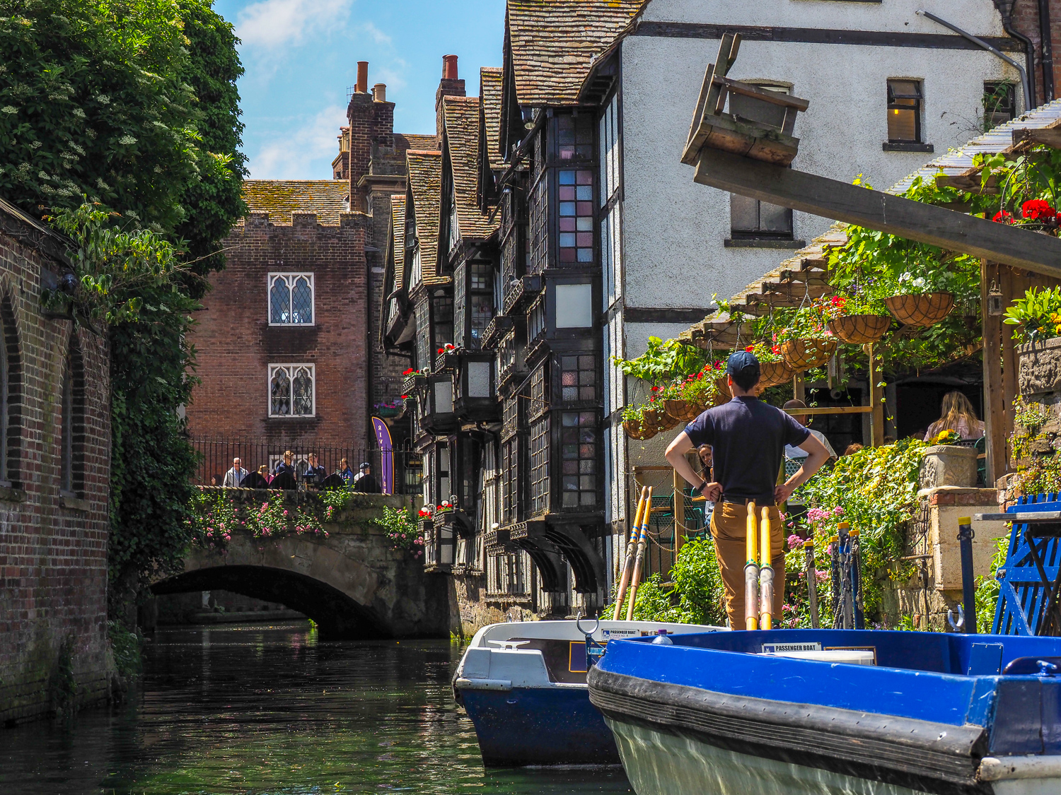 Summer days. Canterbury, Kent, UK. In the upper left is 'the ducking chair'.  This is a chair suspended on a frame hanging over the River Stour. It was used in the middle ages as a form of retribution for three types of situations. Firstly it was used as a punishment for nagging wives. In those enlightened times, a man could pay for his nagging wife to be dipped into the river on the ducking stool and of course suffer a degree of public humiliation at the same time. Secondly, it was used as a punishment and public embarrassment for cheating businessmen, who would be ducked into the water in front of a baying crowd and who would inevitably be forced to leave the city afterwards, their reputation in tatters. Lastly it was most famously used as a litmus test for witches and the way it worked was this: any woman accused of being a witch would be placed in the chair, and the chair would be swung out over the river and then submerged deep in the river for 2-3 minutes. After that time, the poor woman would be brought back to the surface. If she survived this lengthy ducking then clearly she was a witch as she must have used her powers to survive the fatal dowsing. If so, she would be burned at the stake as a witch. If, however, the lady was dead after being submerged for 3 minutes, then clearly she was not a witch.