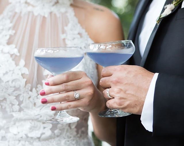 "Would you ever try blue cocktails? Our friend Dave put a special ingredient in these , it is called ""INSTANT HAPPINESS ""👉👉@beyondbartendingllc . . . . . Venue :@heathersglen Photography:@lightraephotographybystephanie Creative direction and Styling: @oliviasourisrose  Gown: @loveandlacedtexas Hair and Make up :@kvbeauty1 Linens @lbl_event_rentals Tableware:@afinerevent Cake:@icednfrostedhouston Custom Stationery: @jospaperkitchen Model couple: @katie_annguidry Speciality Cocktails: @beyondbartendingllc Coordination:@thebrandedcloverweddings Publication: @houstonpwg"
