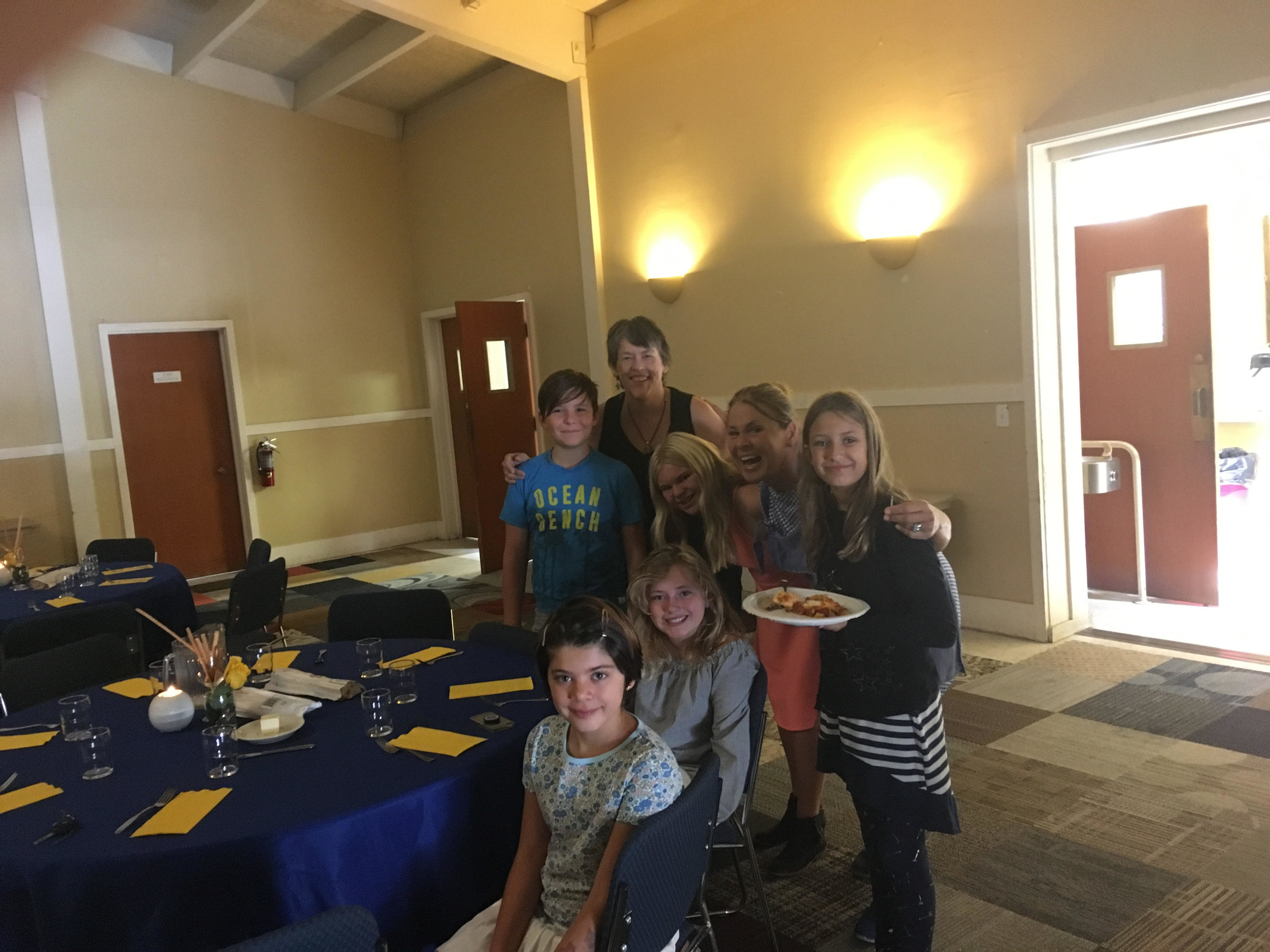 Children helped decorating tables for a church meeting.