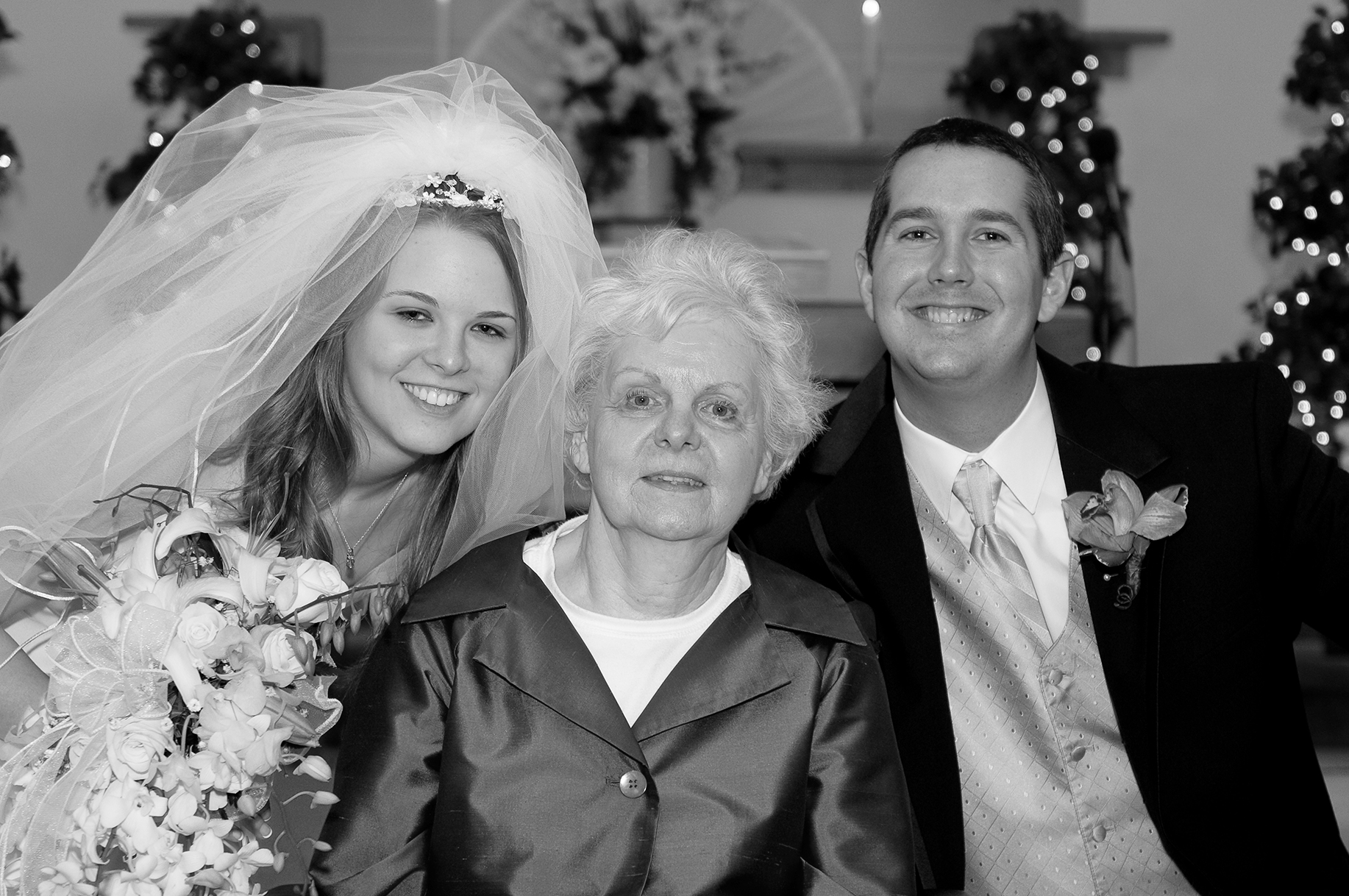 Diane with her granddaughter, Caitlyn, and grandson-in-law, Andrew, at their wedding in 2009