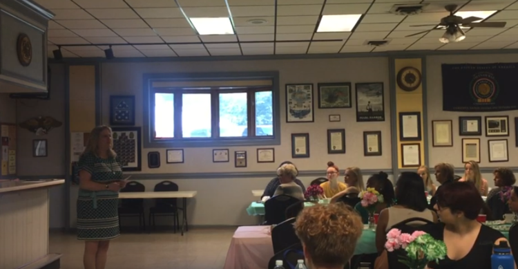 Kim Eley speaking at the Girl Scouts Mother/Daughter Tea on May 21, 2019