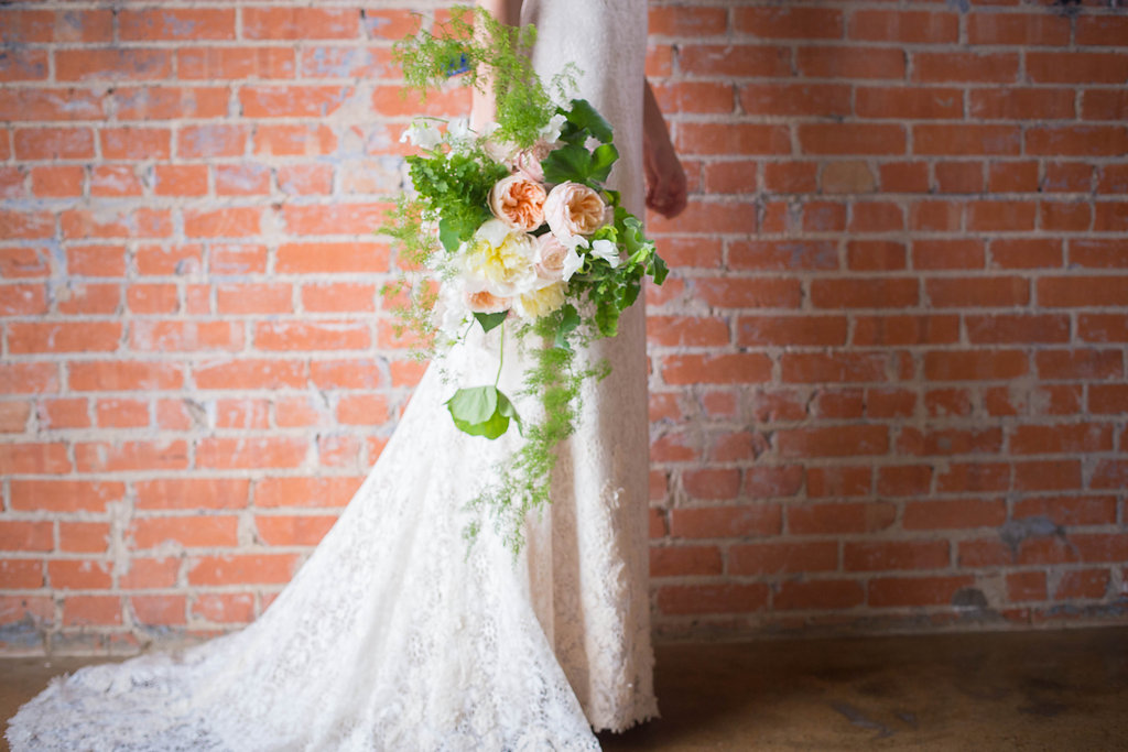 bride-holding-loose-organic-bouquet