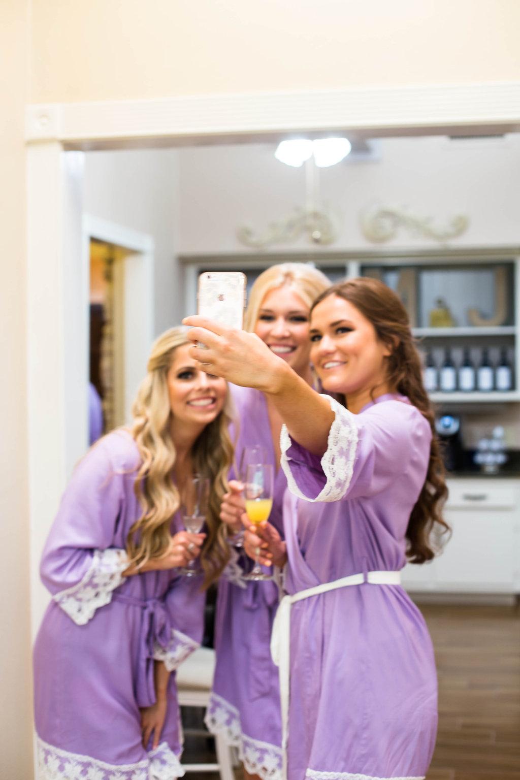 bridesmaids-taking-a-selfie