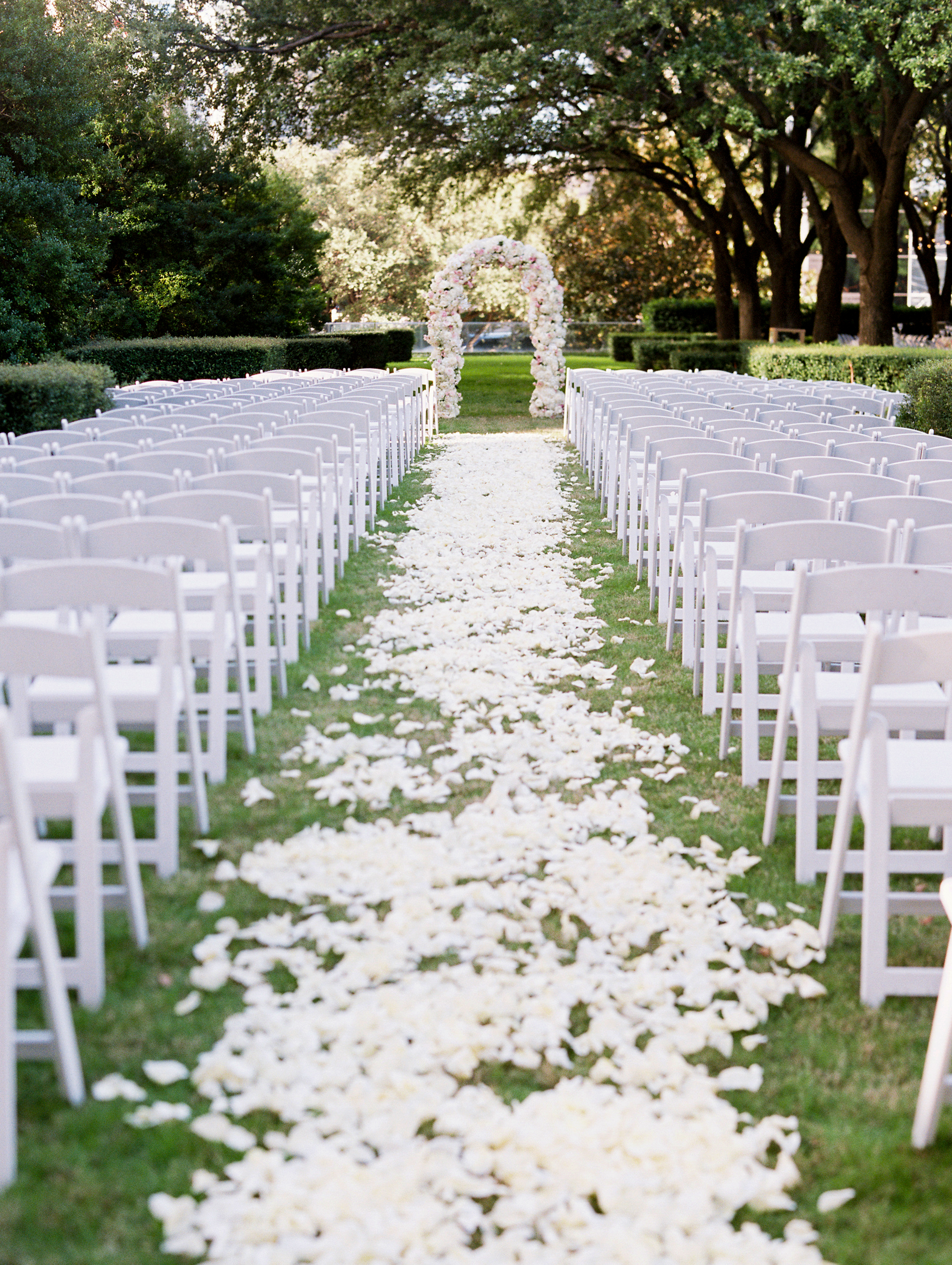 flower_petals_down_aisle_ivory_and_vine_event_co.JPG