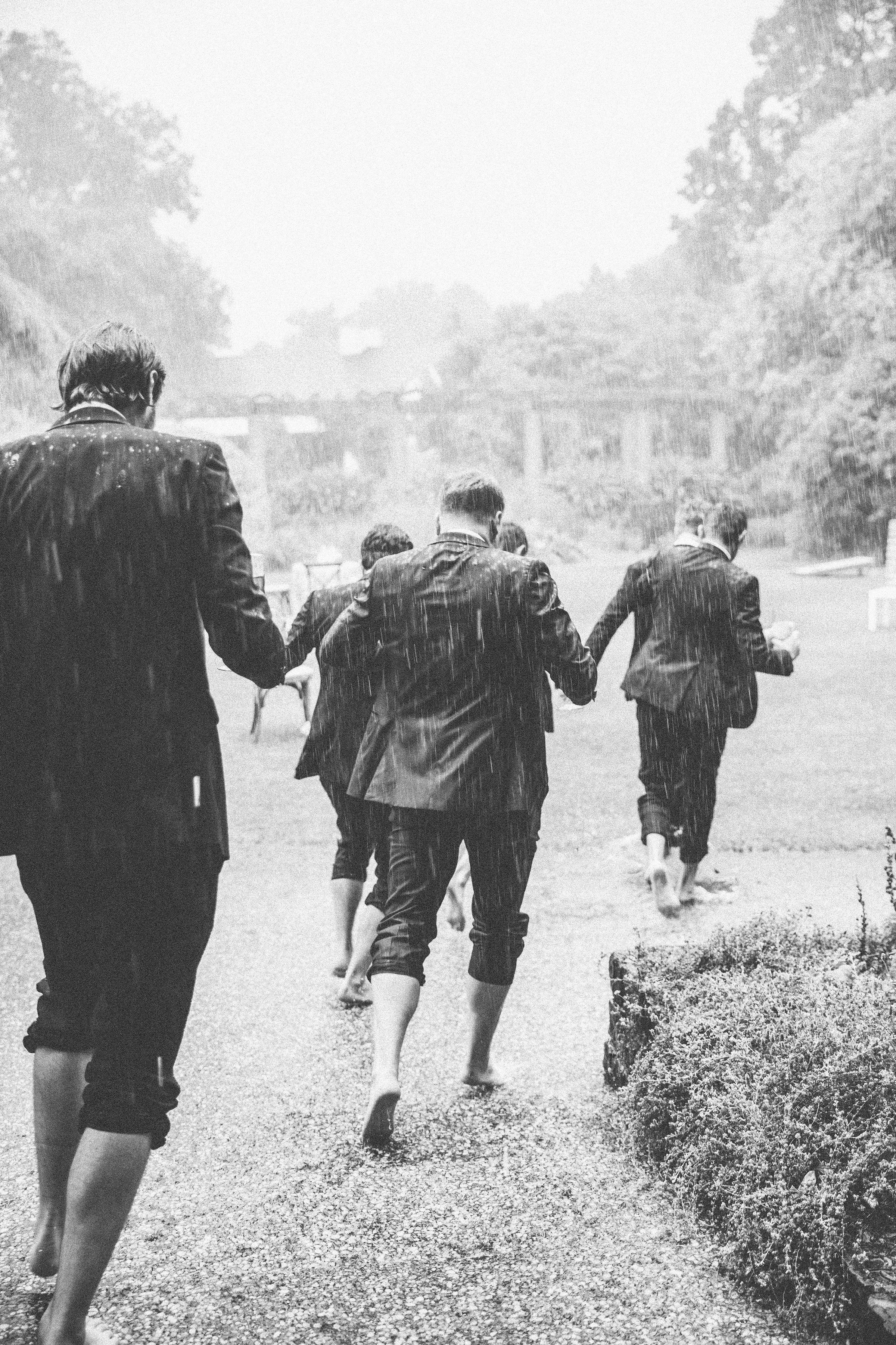 Groomsmen-Run-In-Rain-Ivory-and-Vine.jpg