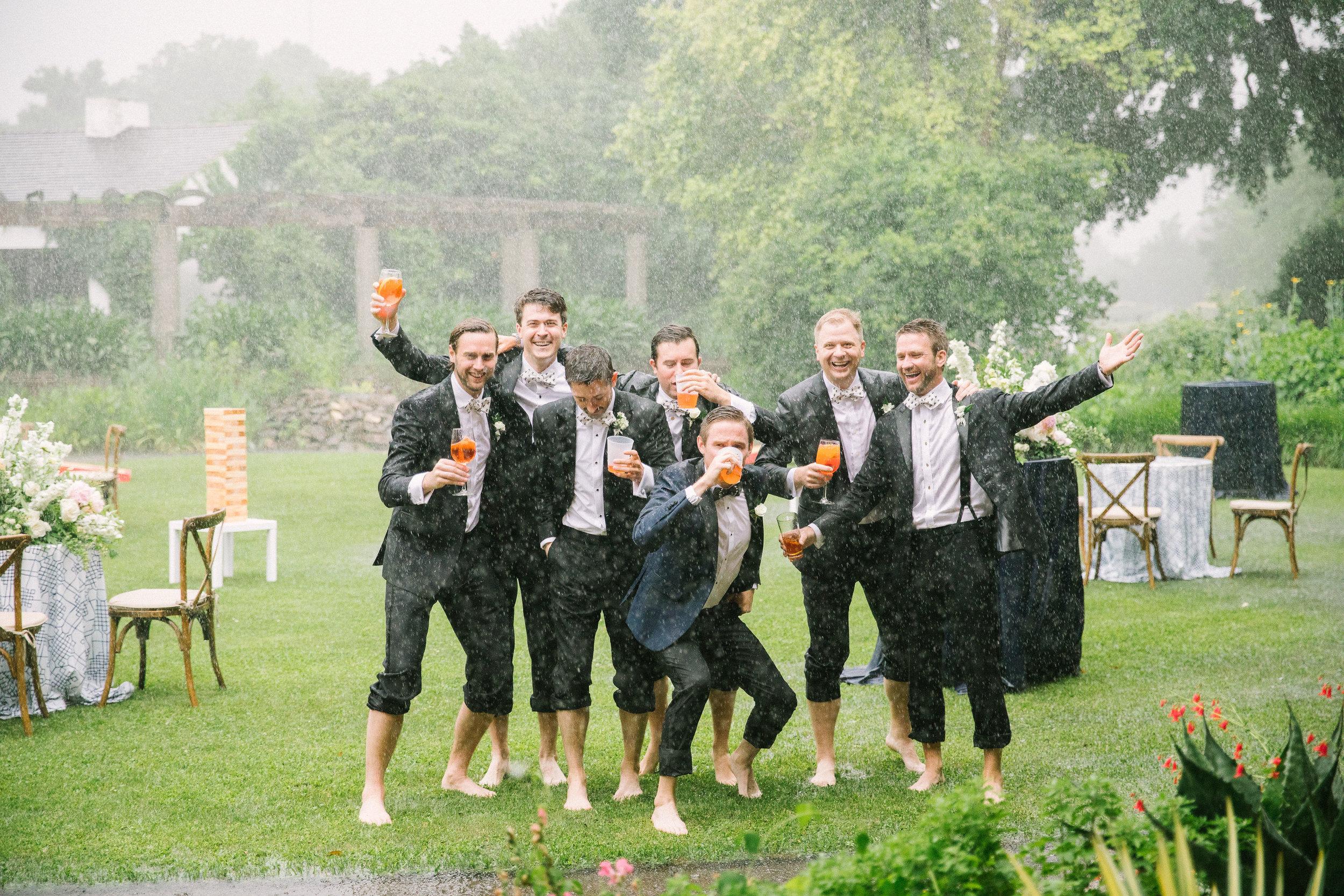Jimmy-And-Groomsmen-In-Rain-Ivory-and-Vine.jpg