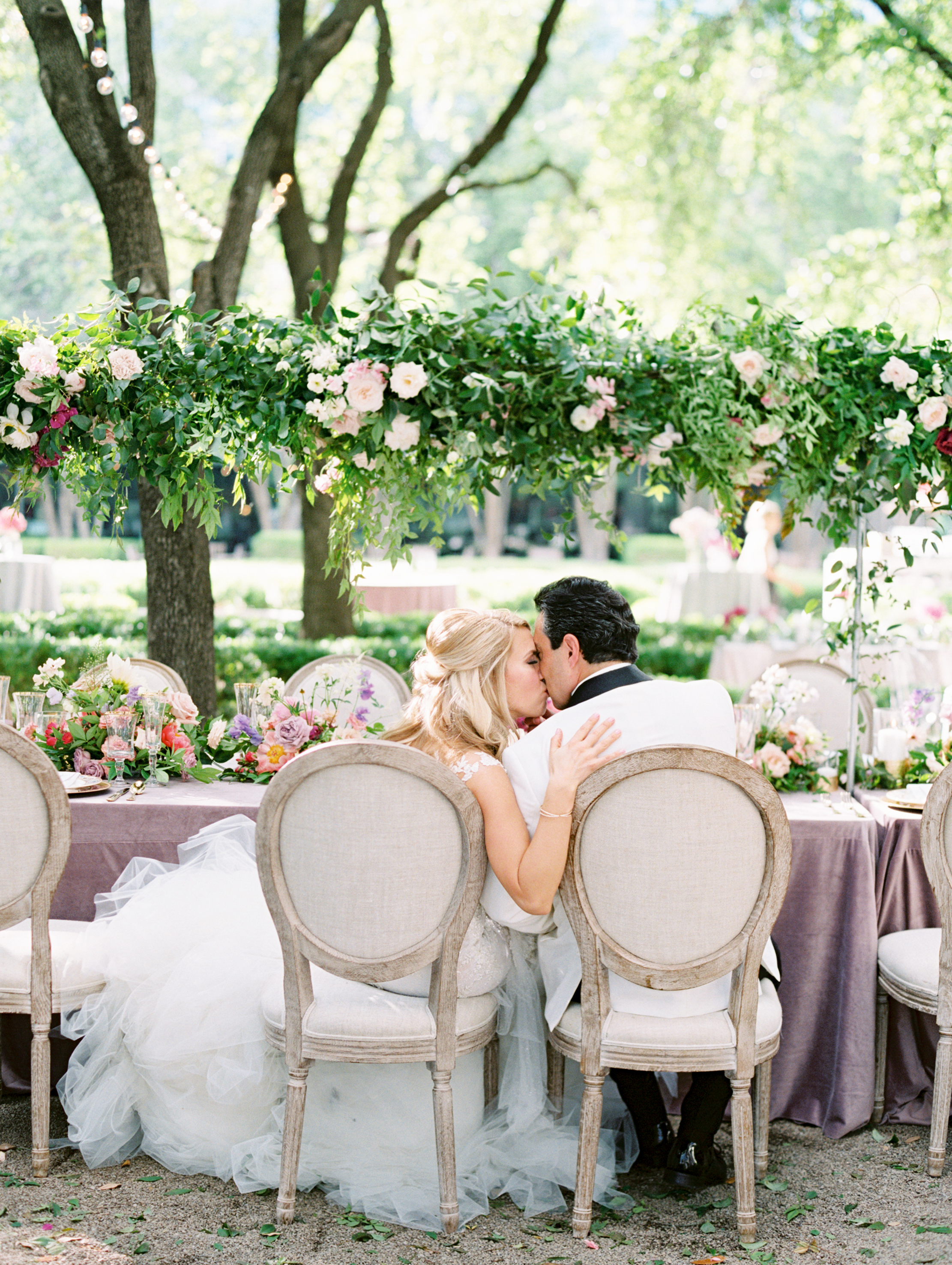 Blakeley-and-Alex-Sweethearts-at-Head-Table-Ivory-and-Vine.JPG