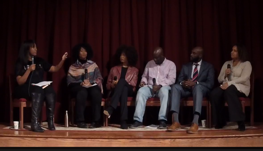 Saba Nwankpah, the panel moderator, is seated to the left. The panelists (from left to right) are: Yolanda Moore, Carol Griffin, Dwight Francis, Elroy Pierre, and Rossy Mendez. Screen capture of the live-stream video.