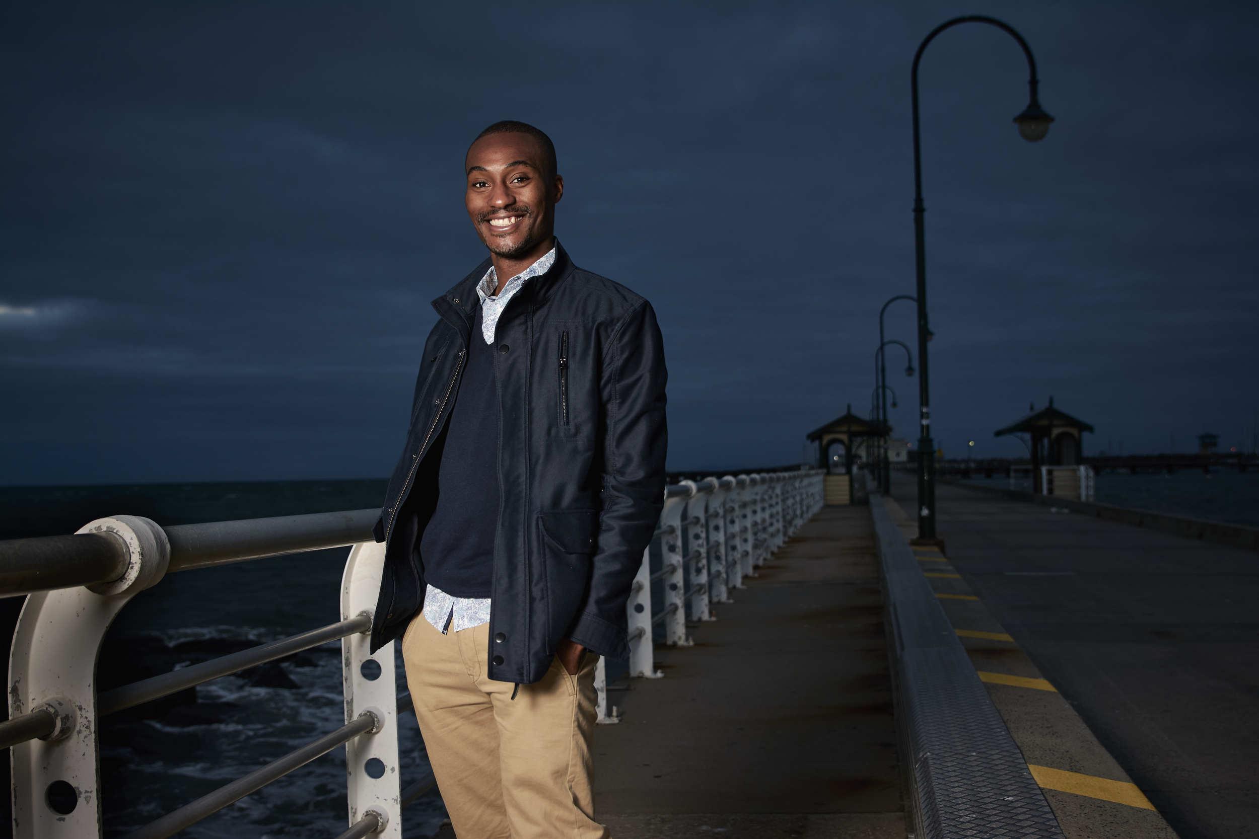 Alex standing on St Kilda Pier Melbourne engagement session.jpg