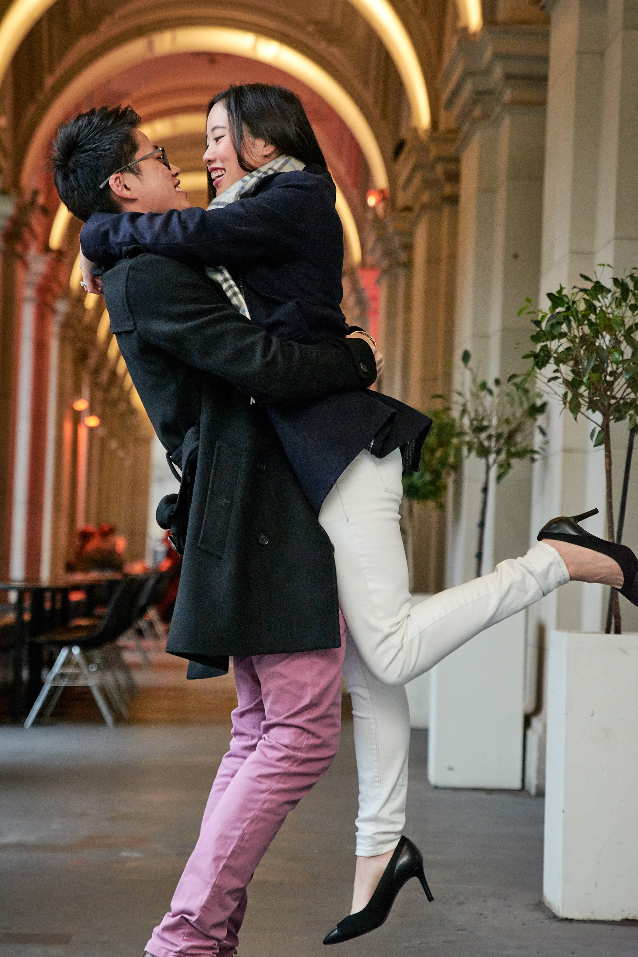 Bella and Emerson lift pose in Melbourne GPO engagement session.jpg