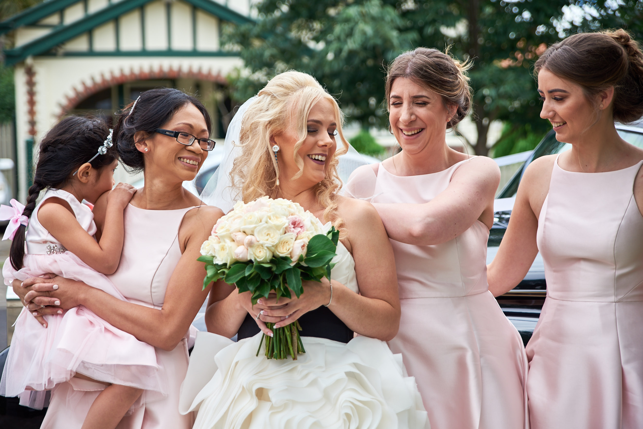 Bride and bridesmaids laughing