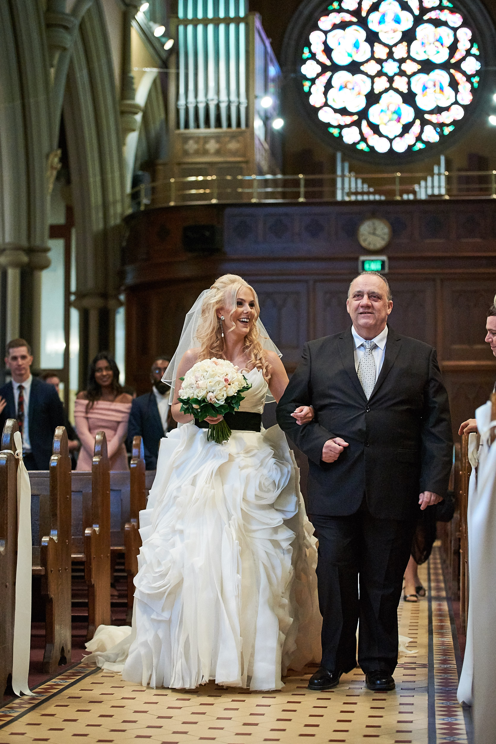 Bride and father walking down aisle at St Mary of the Angels Basilica church in Geelong